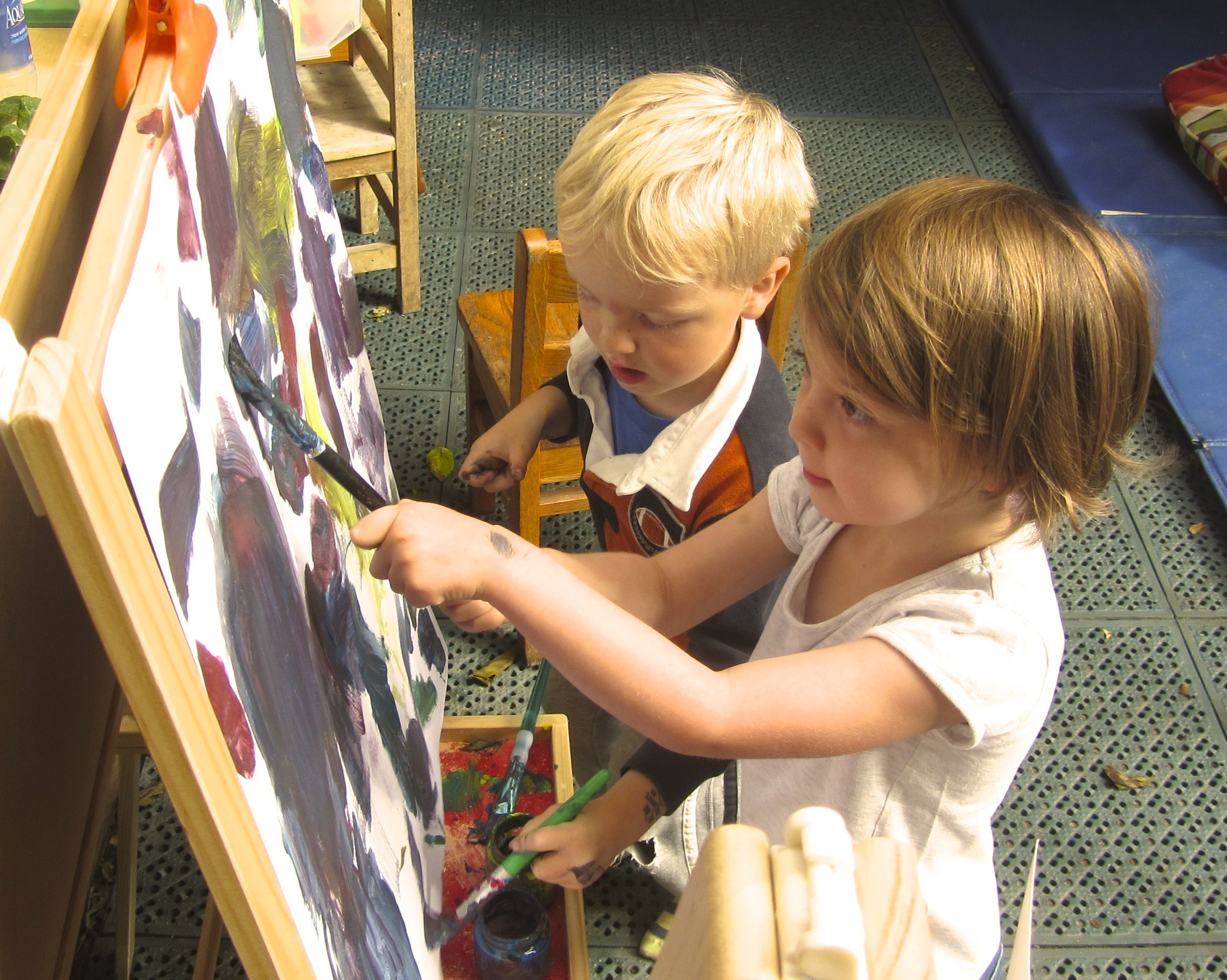 Painting is both a sensory experience for children and a form of creative expression.