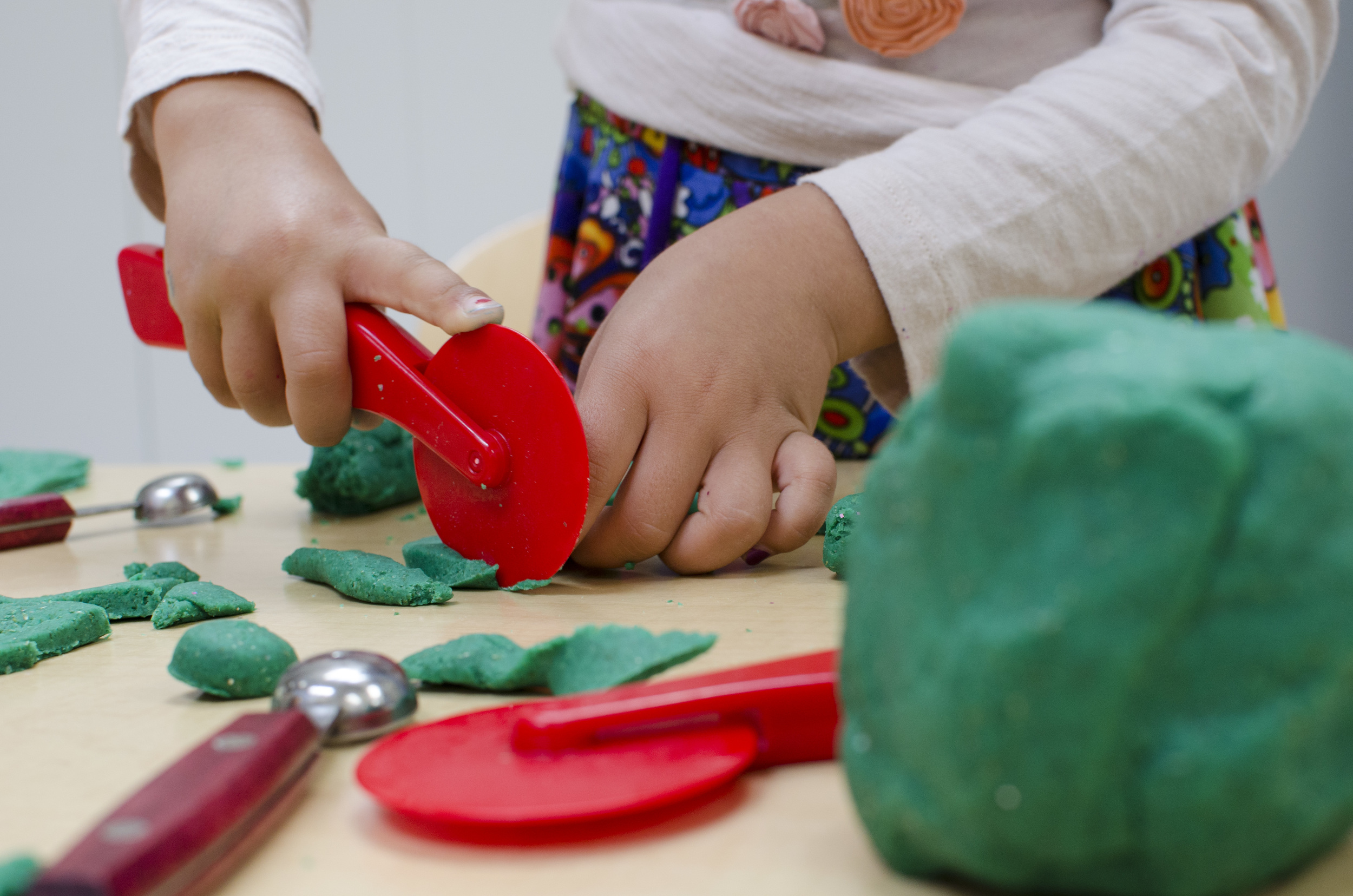 Playdough is soothing to touch, has an infinite number of uses in imaginary play, offers opportunities for sharing, and strengthens the muscles in fingers and hands.