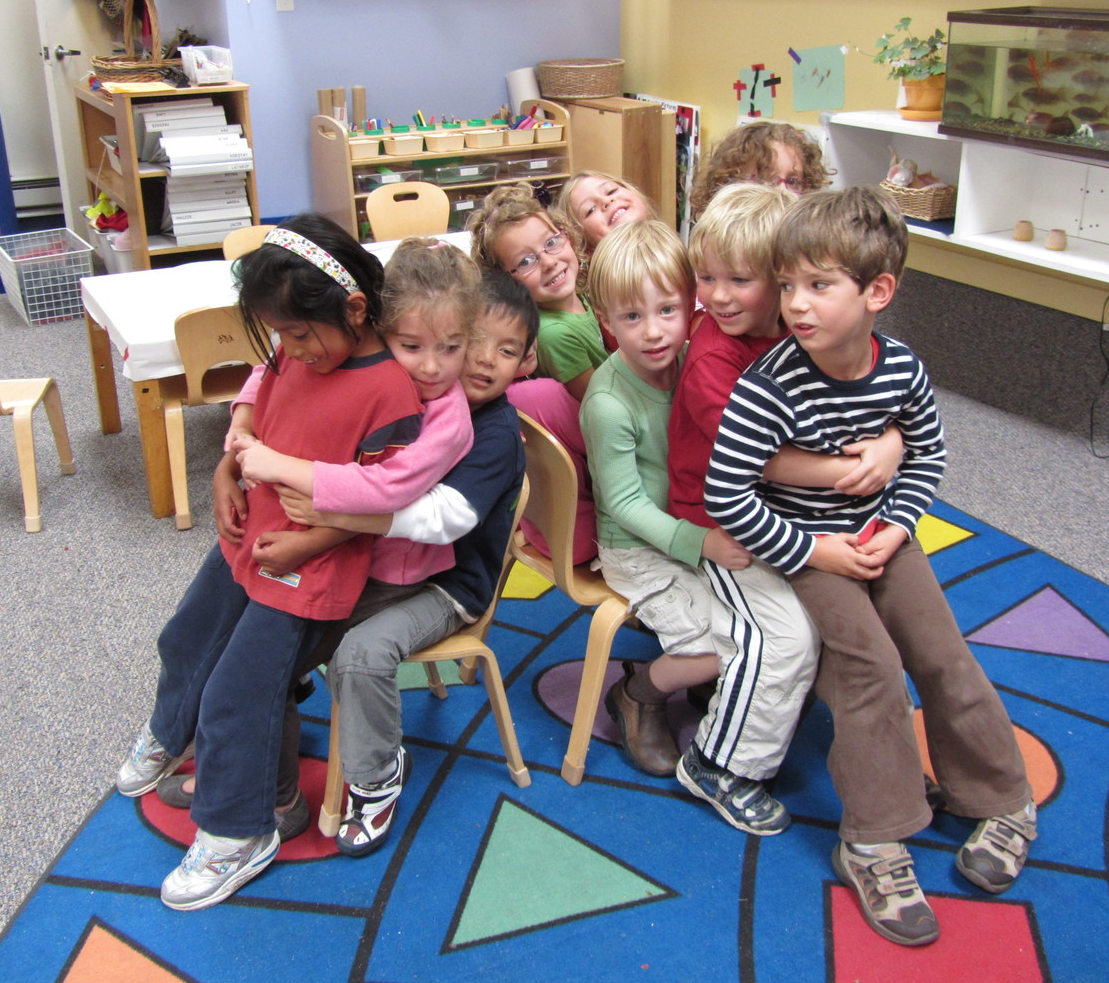 Working together in a group game develops important skills like turn taking, rule following, and team building.