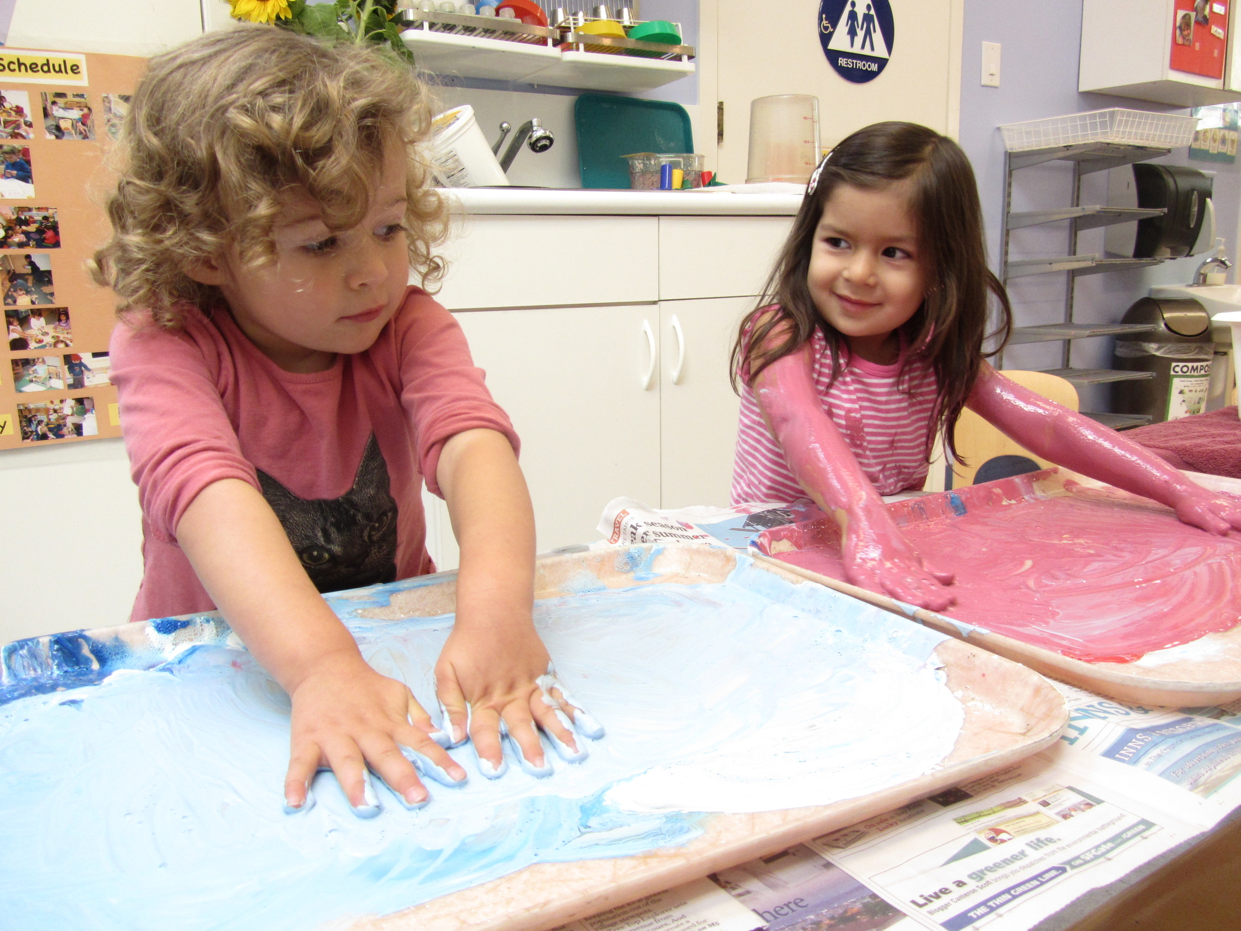 "The sensory input children receive from tactile (""messy"") materials prompts the brain to process and organize information about the environment.  Children grow to tolerate new textures and can become quite absorbed in the investigation process."