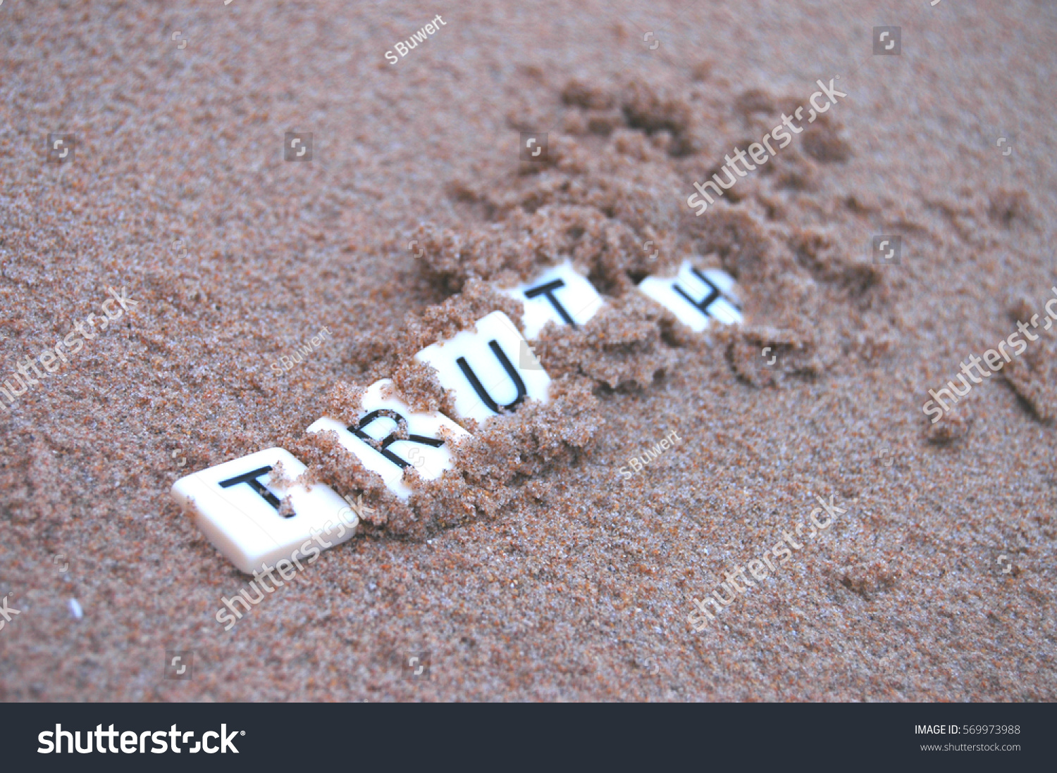 stock-photo-post-truth-letters-spelling-truth-becoming-buried-in-sand-569973988.jpg
