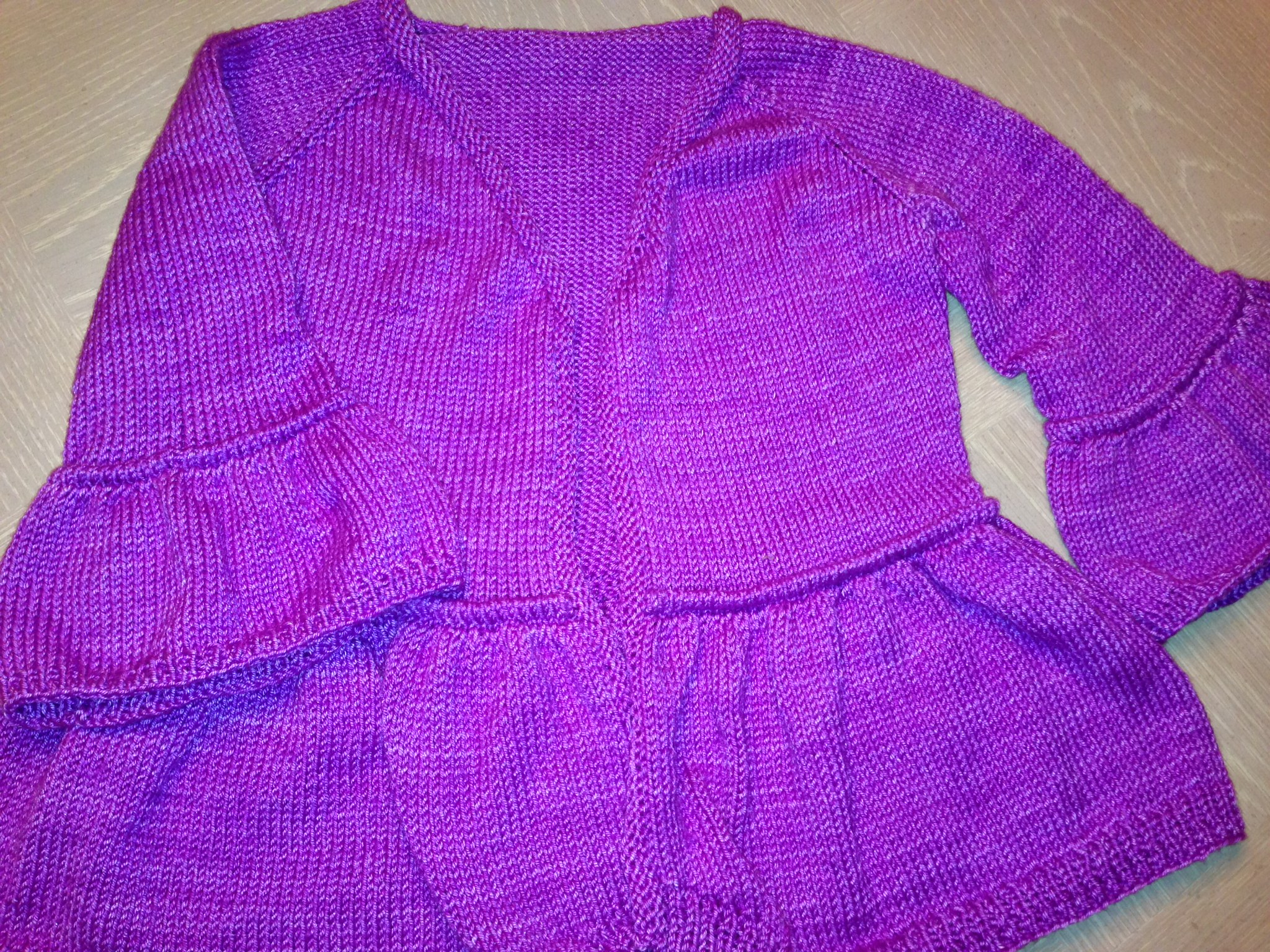 Here is one of the sweaters I knitted while away from the studio. The next project is a pair of socks! The yarn and pattern for this sweater are from  The Knot House  in Frederick,Maryland. I did change the sleeves of this pattern a little bit to mimic the flounce at the bottom of the sweater!