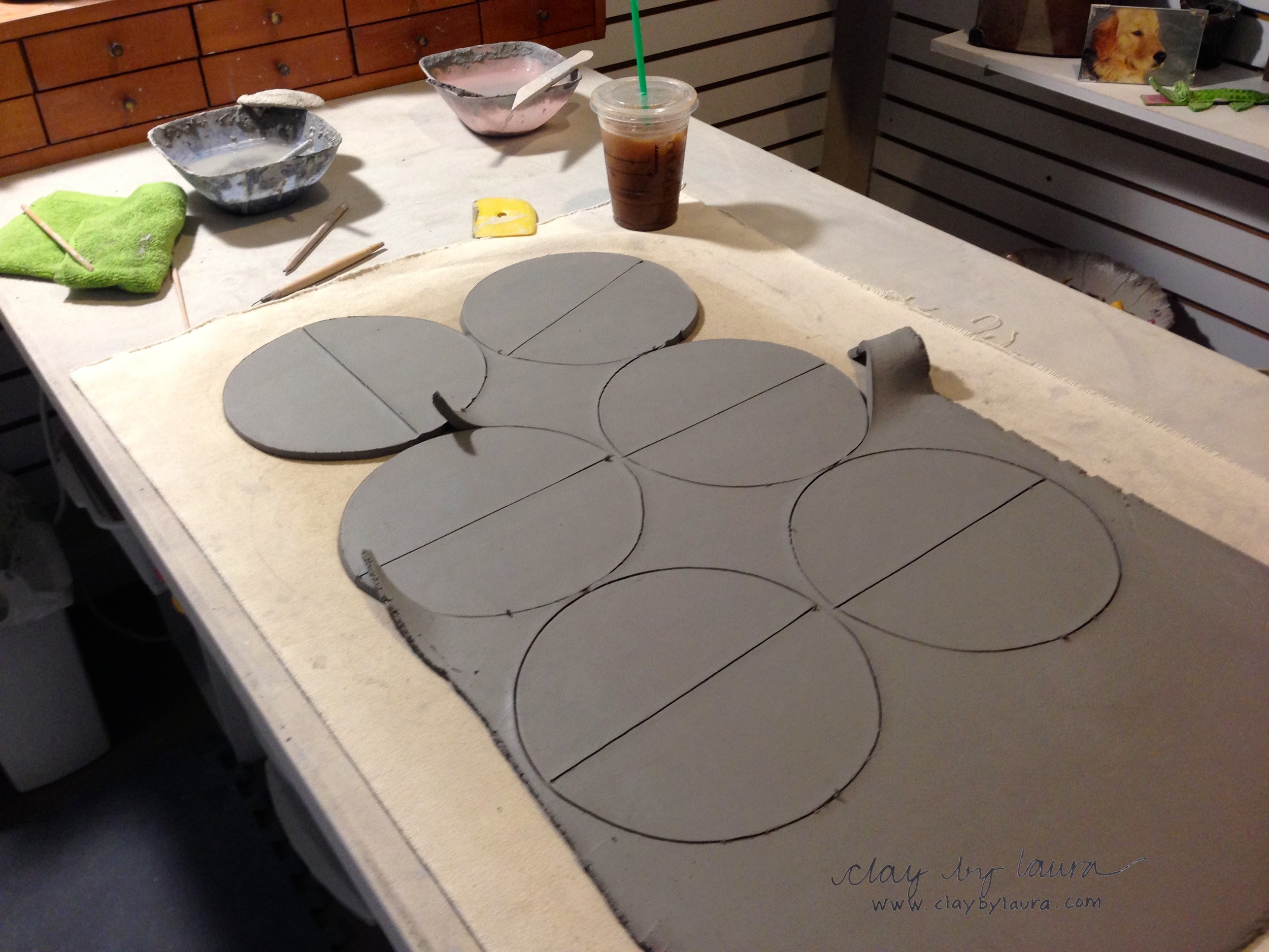 Next I cut out the shape of the clay using a template I've made. In this case it is a circle which I cut in half.