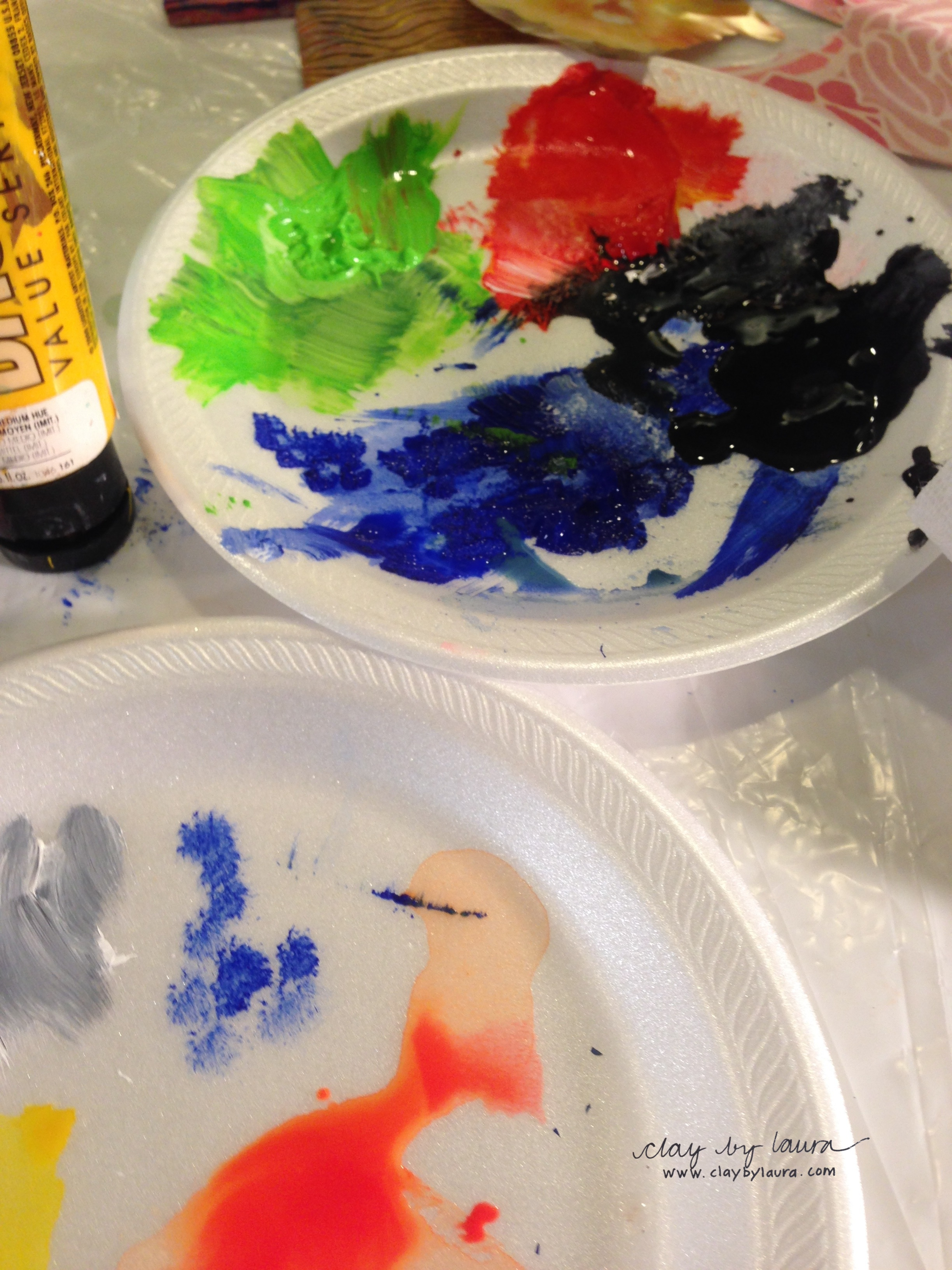 We used acrylic paints in varying degrees of transparency.