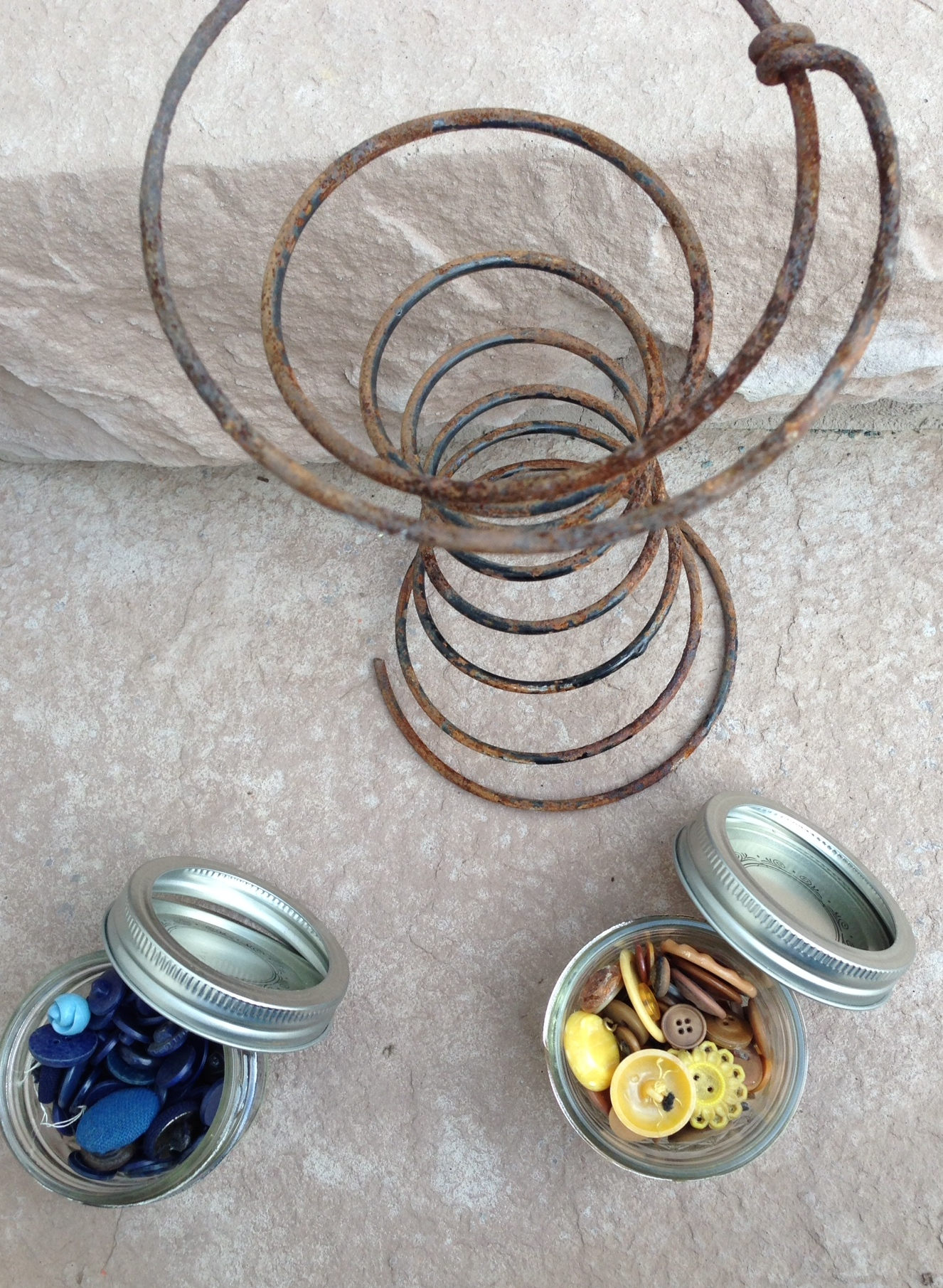 Here is my latest purchase from the Barn Sale. I use the buttons in several of the garden pieces I make. I was intrigued by the rusted bedspring and will look for a way to use it in my work!