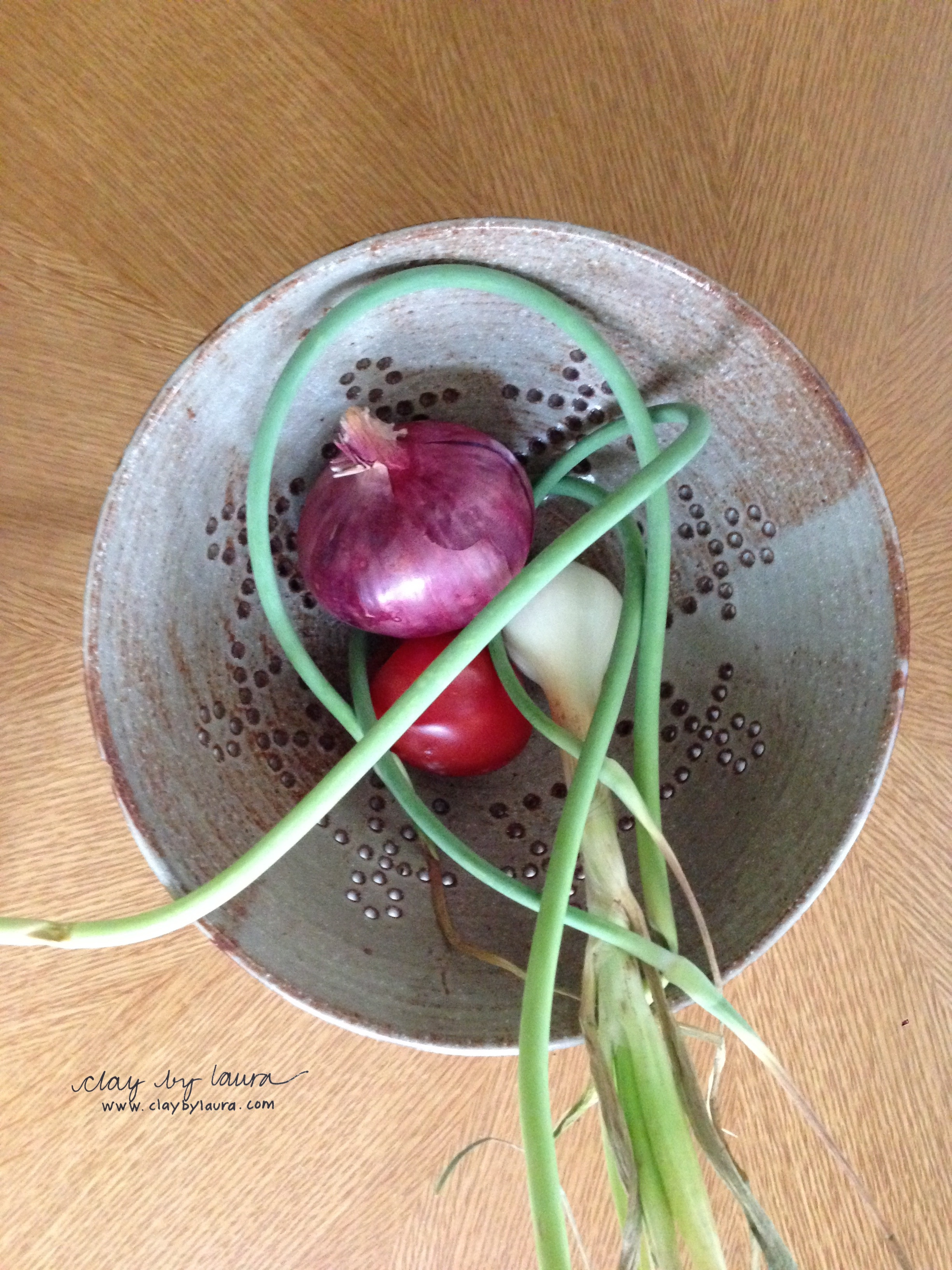 Bowls with holes can be used to wash and store vegetables or fruit.