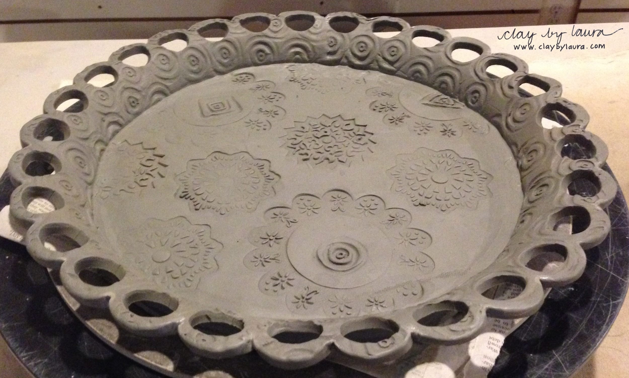 Here is another version of the cake plate idea. The holes can be used for stringing colorful ribbon.