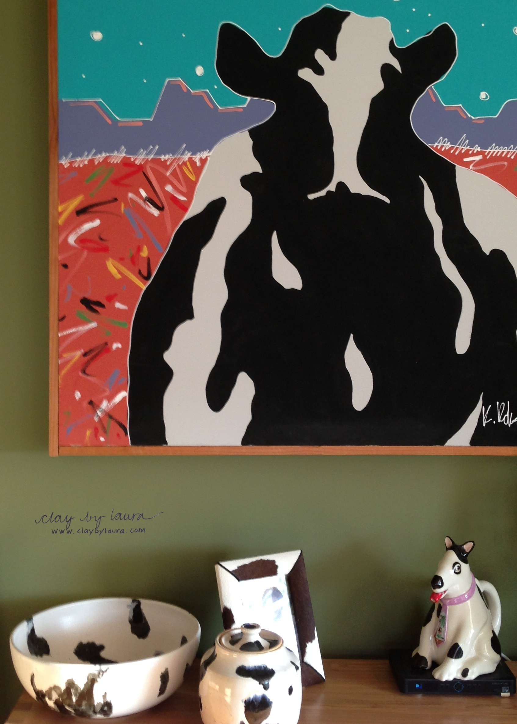 I like to display and group collections of my work and other art throughout our house.