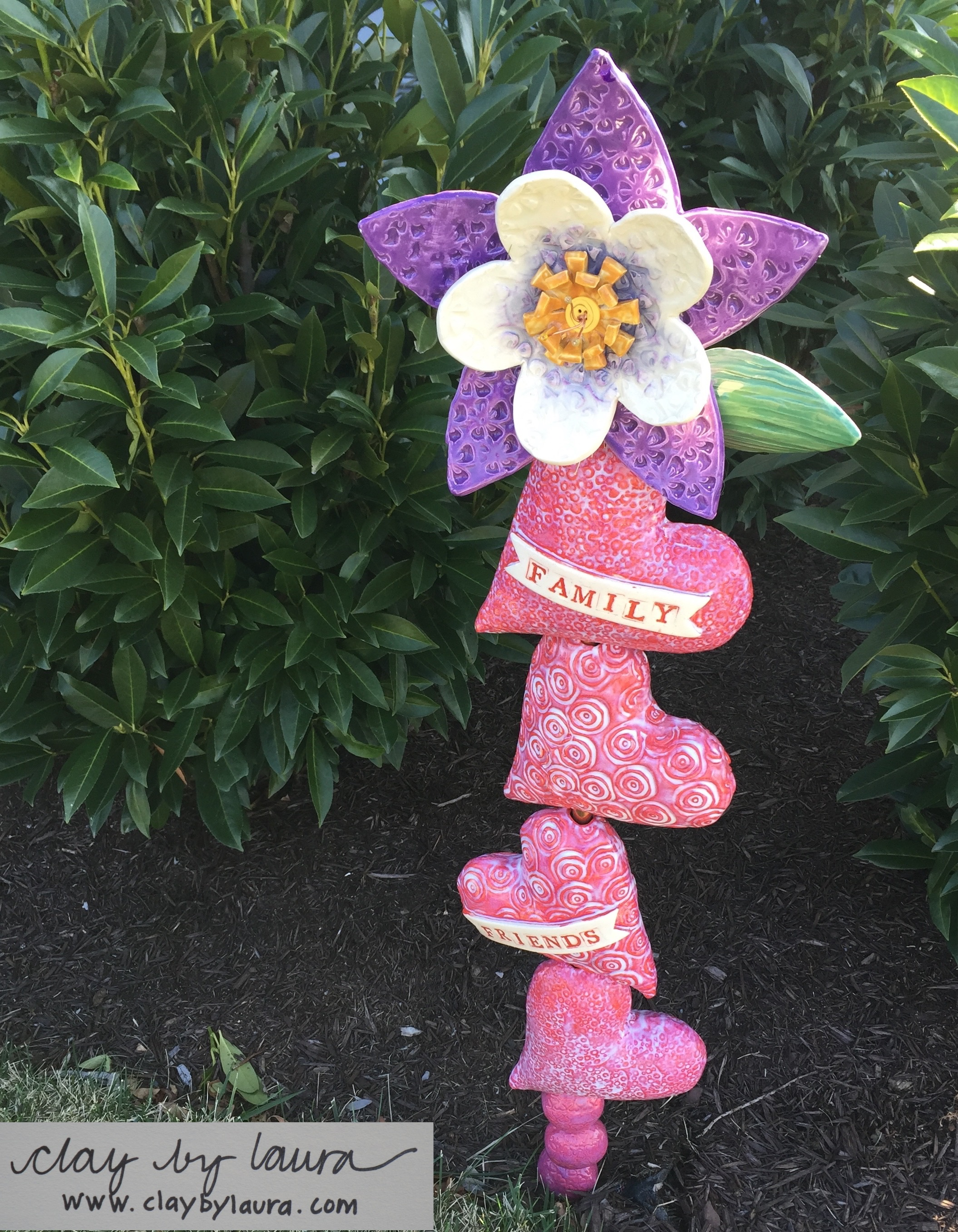 This totem will enhance a garden inColorado. Itfeaturesthe state flower Columbineand several heart shapeswhich hold special meaning to the owner. Totems can be displayed outdoors year-round in all kinds of weather conditions!