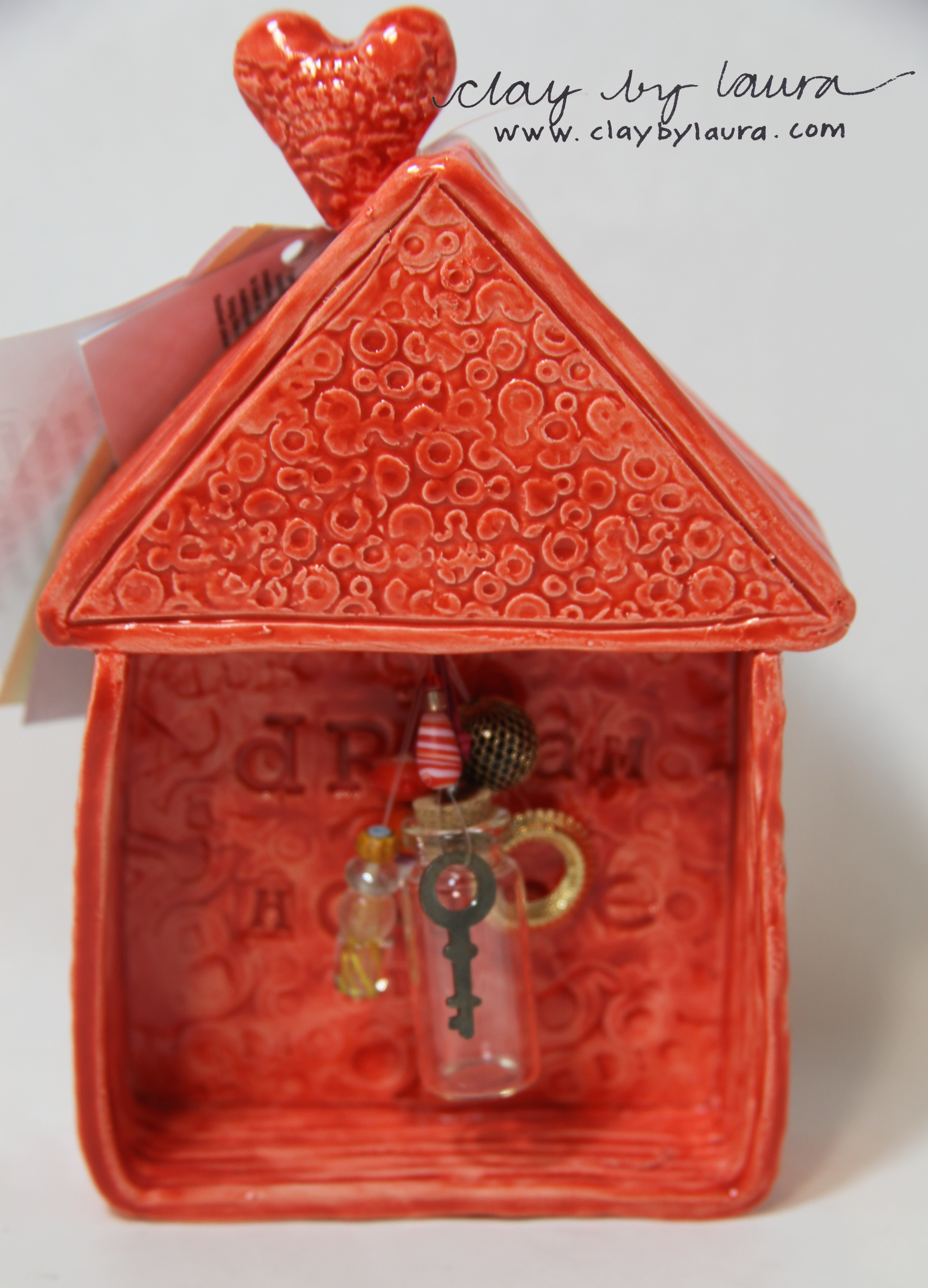 The owner of this 'Dream House' can store any hopes, wishes or dreams written on a slip of paper and placed in the glass vial. Spend $104 to send one of these to your Valentine.