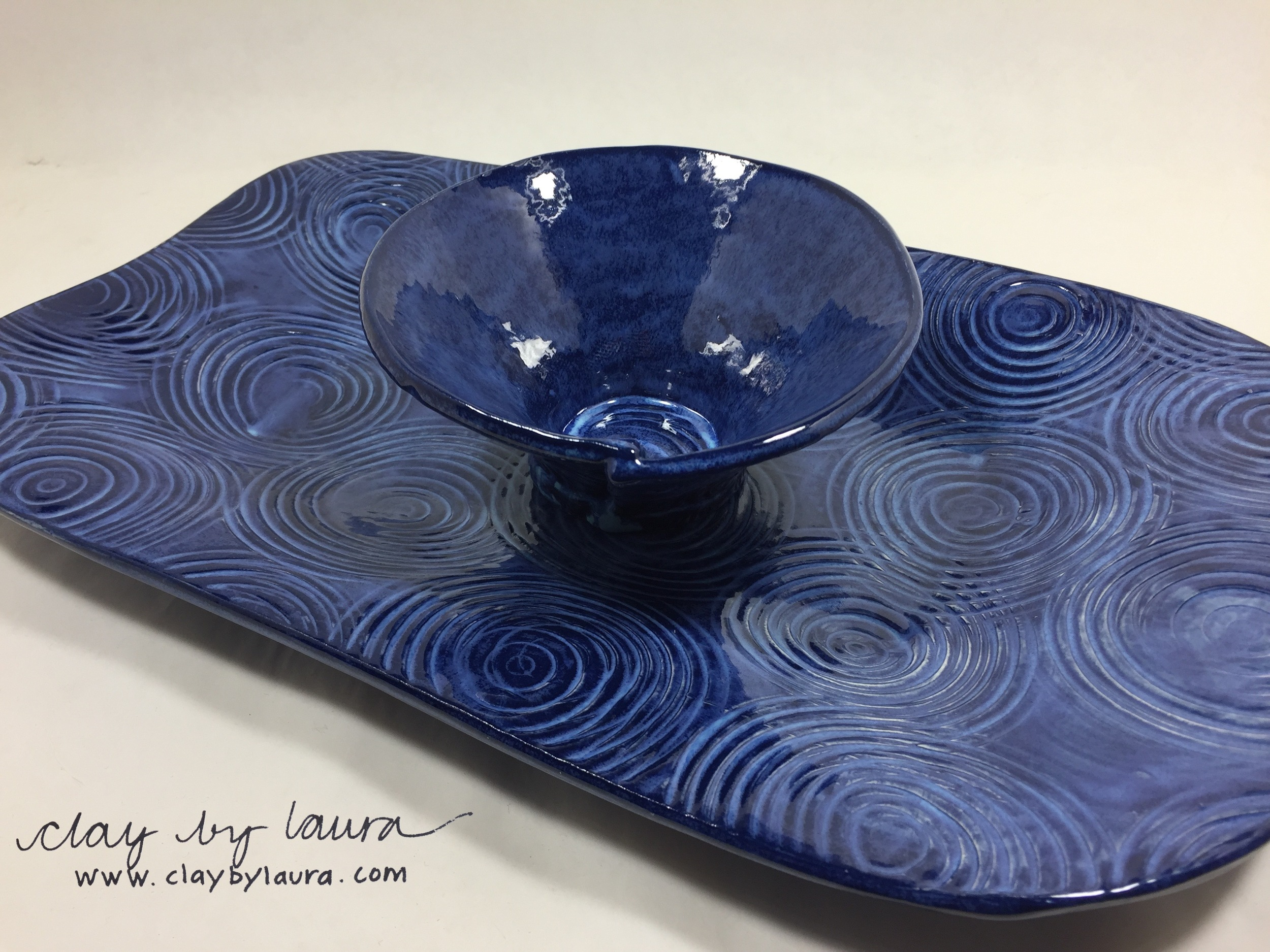 I have made this popular tray and bowl set for many years. Each one is a unique combination of pattern and color. The serving bowl has evolved over the years into the current circle form. If a customer sees a piece of mine that has been sold at a show or is out of stock in my inventory, I can easily make a new one!