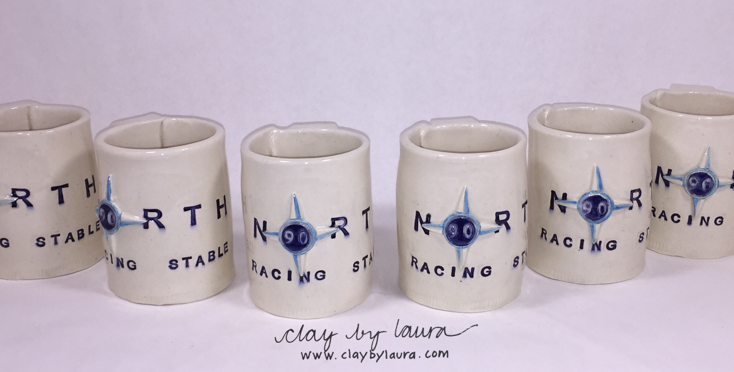 This set of mugs uses a company logo as the basis for the decoration and colors. It took a couple of tries to get this commission to completion, but that's part of the process!