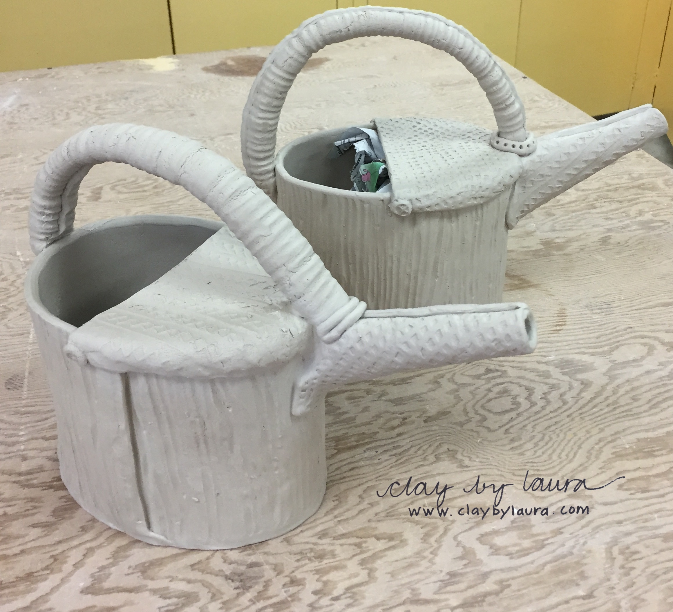 I'm confident Spring will arrive eventually. In preparation, I'm developing a new watering can shape that can be used to nourish a growing garden or plant and hold a bunch of freshly picked flowers for display!
