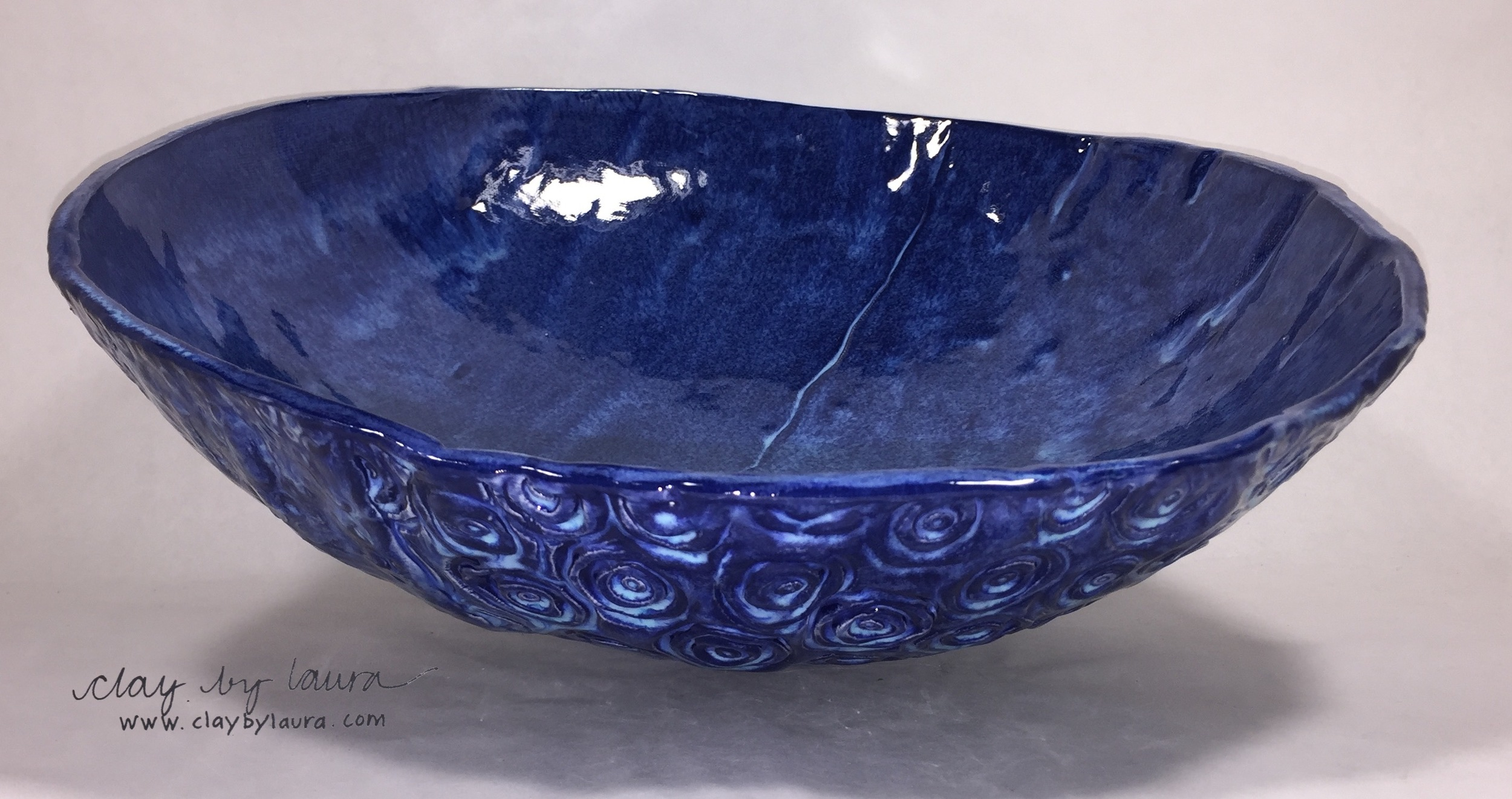 I like the undulating form of this bowl. I think it accurately portrays how I've loosened up in the studio!