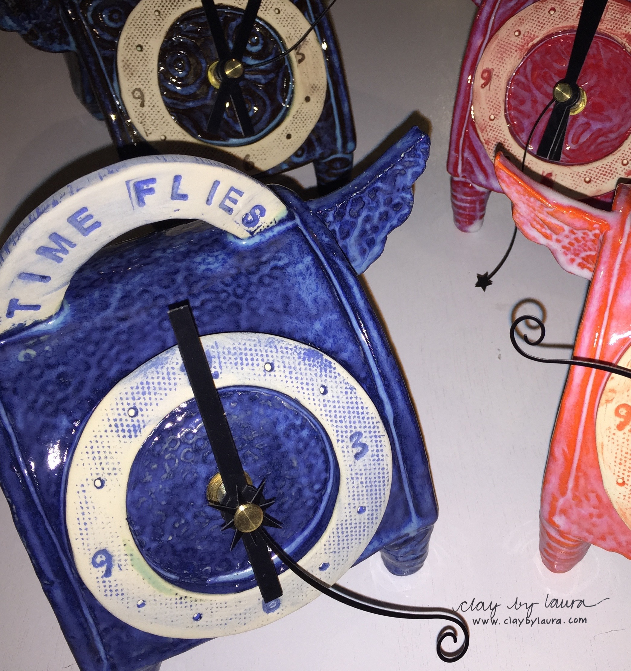 My angel-inspired clock is a new direction for me. I like the contrast of the glazed and unglazed surface areas!