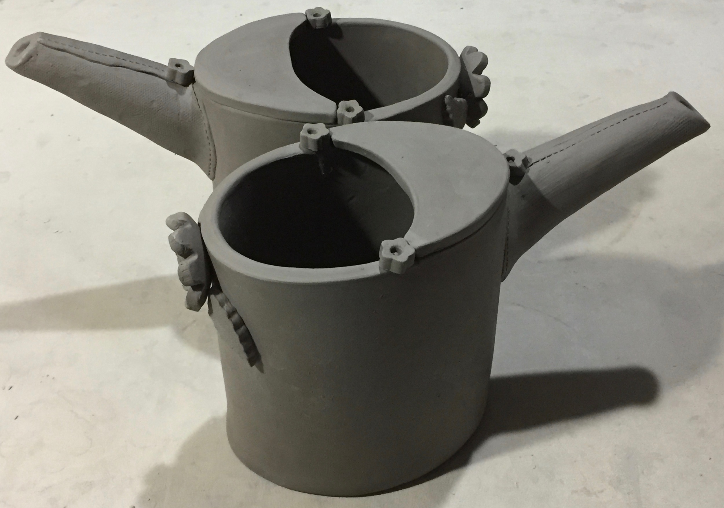 I've tweaked my watering can design this year and eliminated the handle, The flower button at the back and neck of the spout can be held to pour water. When it's not being used to water, it can be used to showcase a large bunch of flowers. I think about the functionality of my pieces a lot. I make and design items I want to use in my own home. I'm always thrilled when I hear how purchasers use my ceramics -- often in ways I hadn't even thought of!