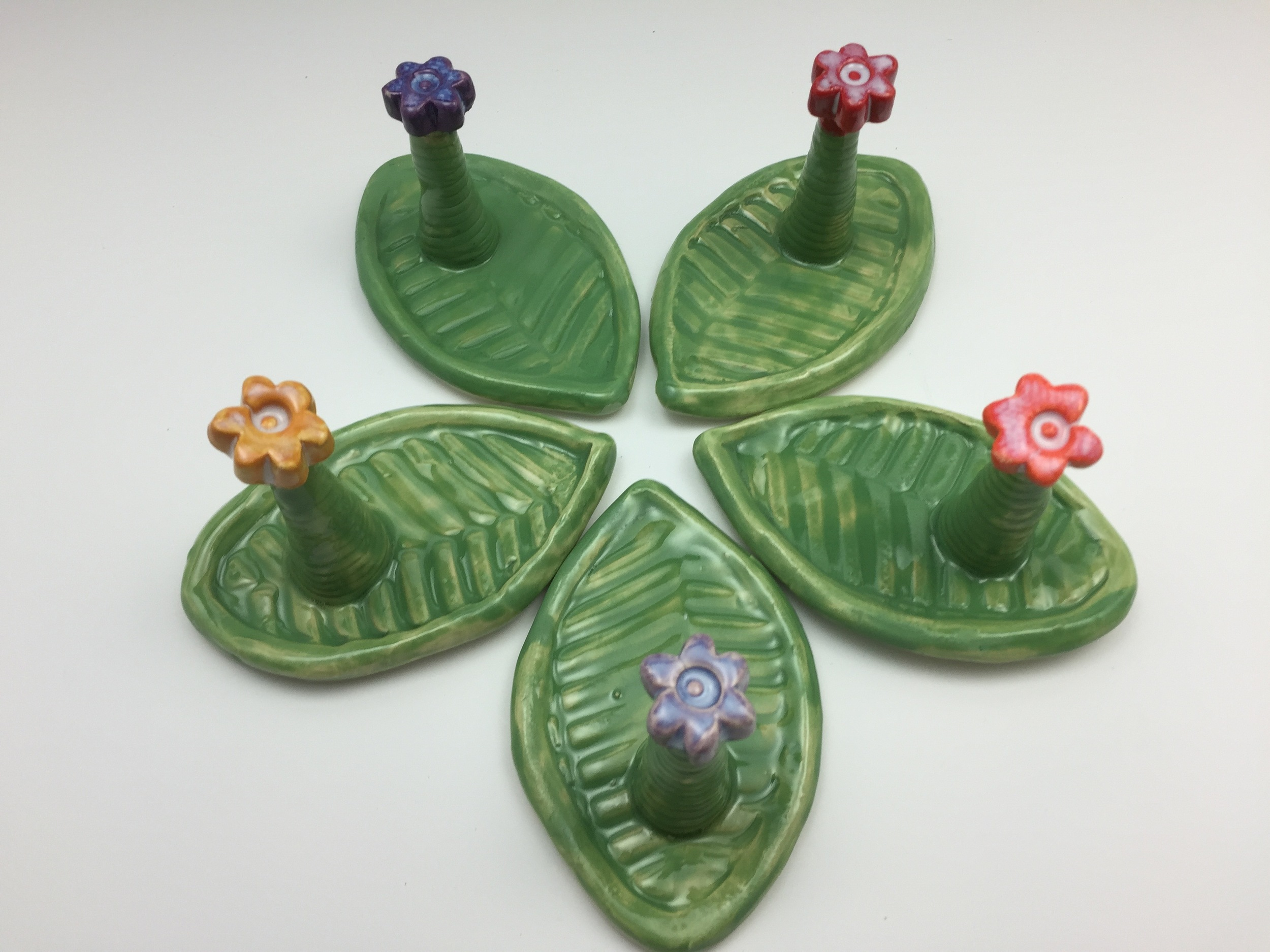 I'm excited about the design of these little ring-holder dishes. I am happy with the overall look, but still need to make some adjustments for total functionality. The creative pottery process takes time and often requires adjustments. I don't find it frustrating -- in fact it's invigorating and keeps me going back to the studio time and again!