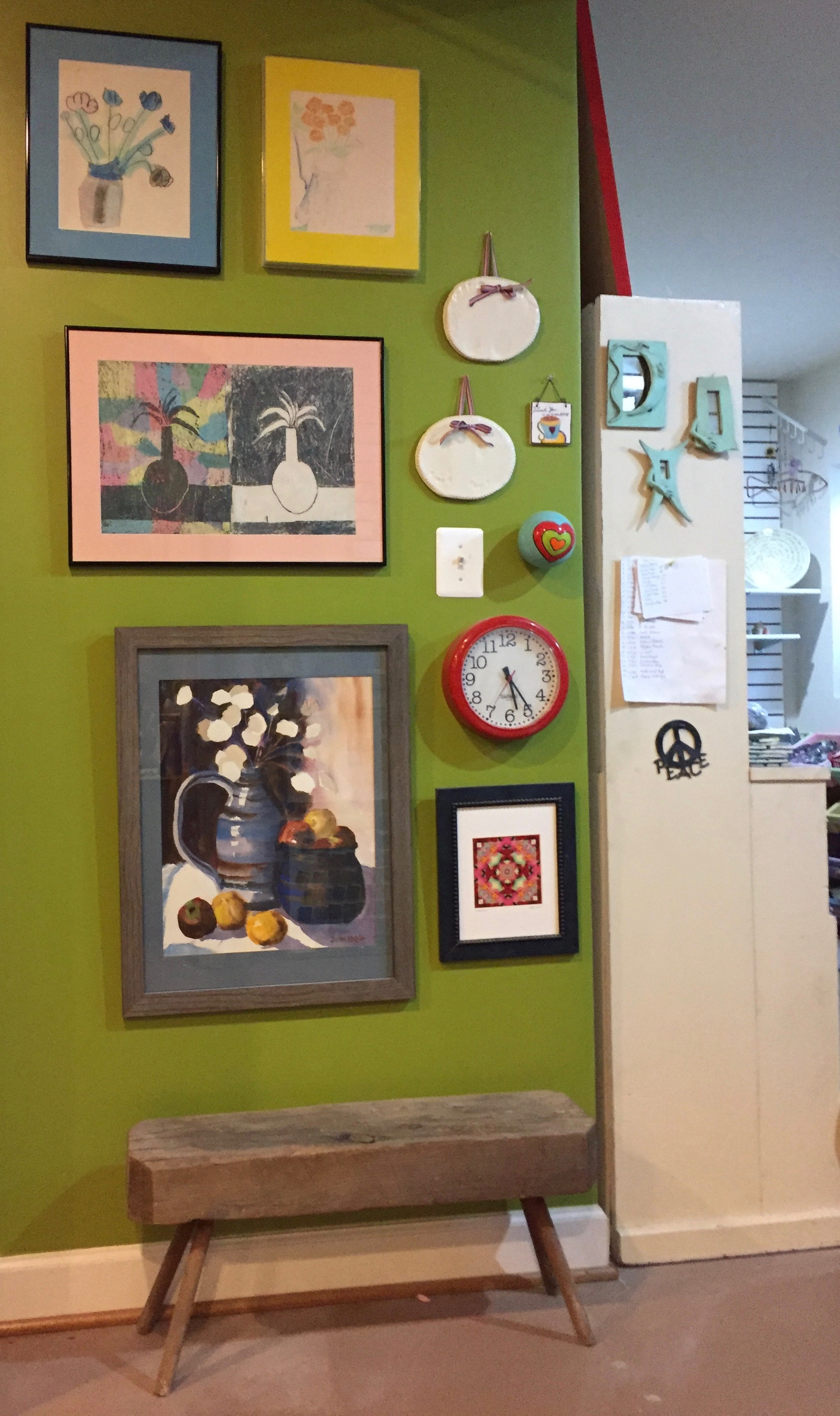 I'm inspired by the art I've collected over the years and surround myself with it in my studio. This wall features art by a family friend, art gifts I've received, art by my children and a watercolor I made as a teenager.