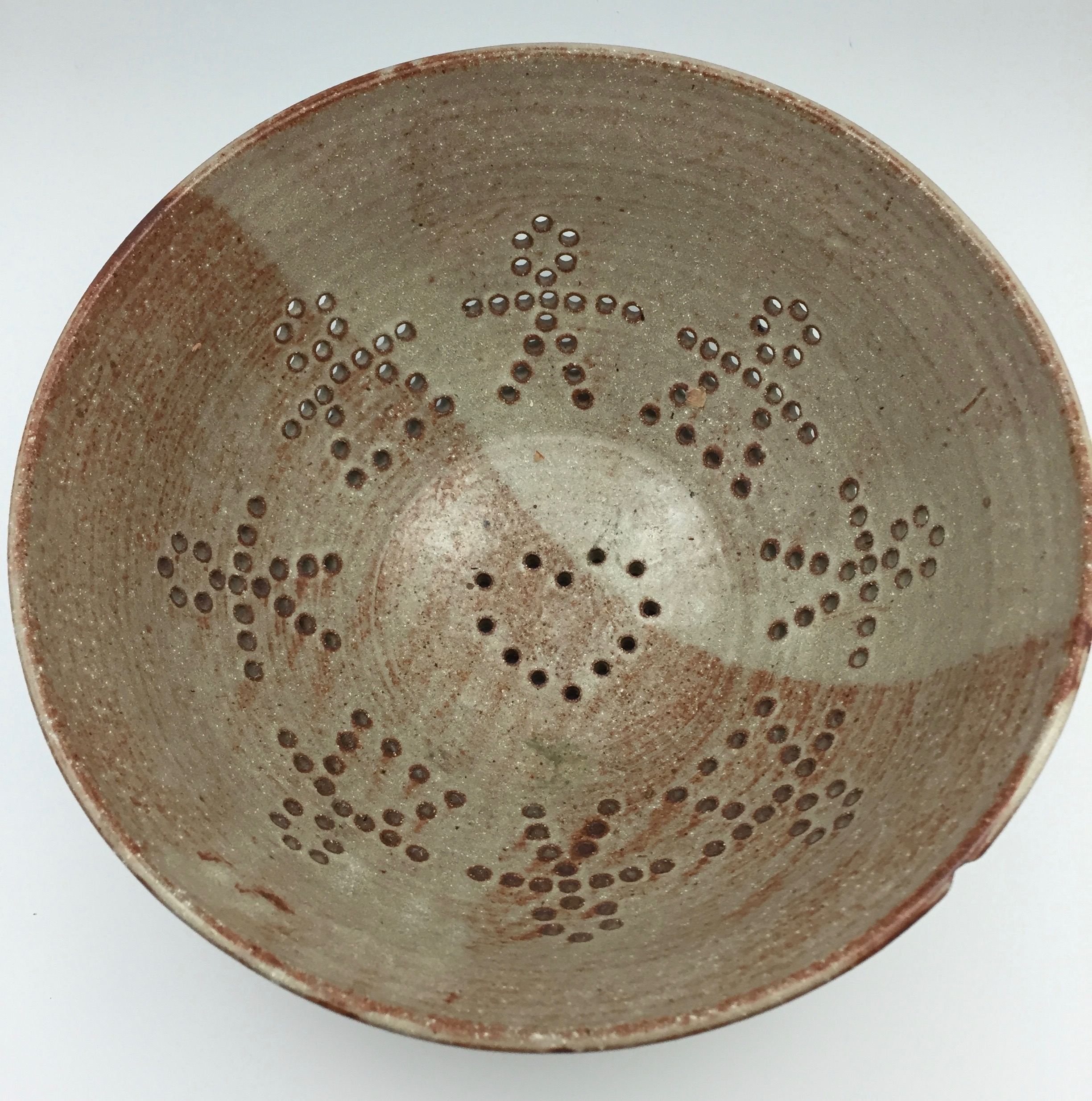 When I made this colander in 1994, I wanted the holes to be part of the design. I liked the idea of using a cut-out doll image encircling the bowl with a heart at the base. It's still one of my favorite patterns!