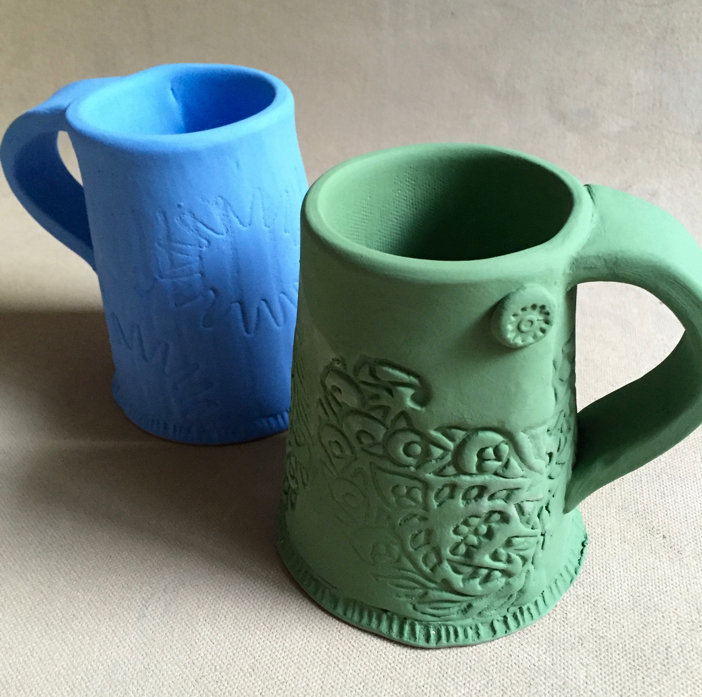 This is a new mug form for me. I chose to have a wider base and narrow top. This helps the functionality of the mug by keeping a hot beverage hot.