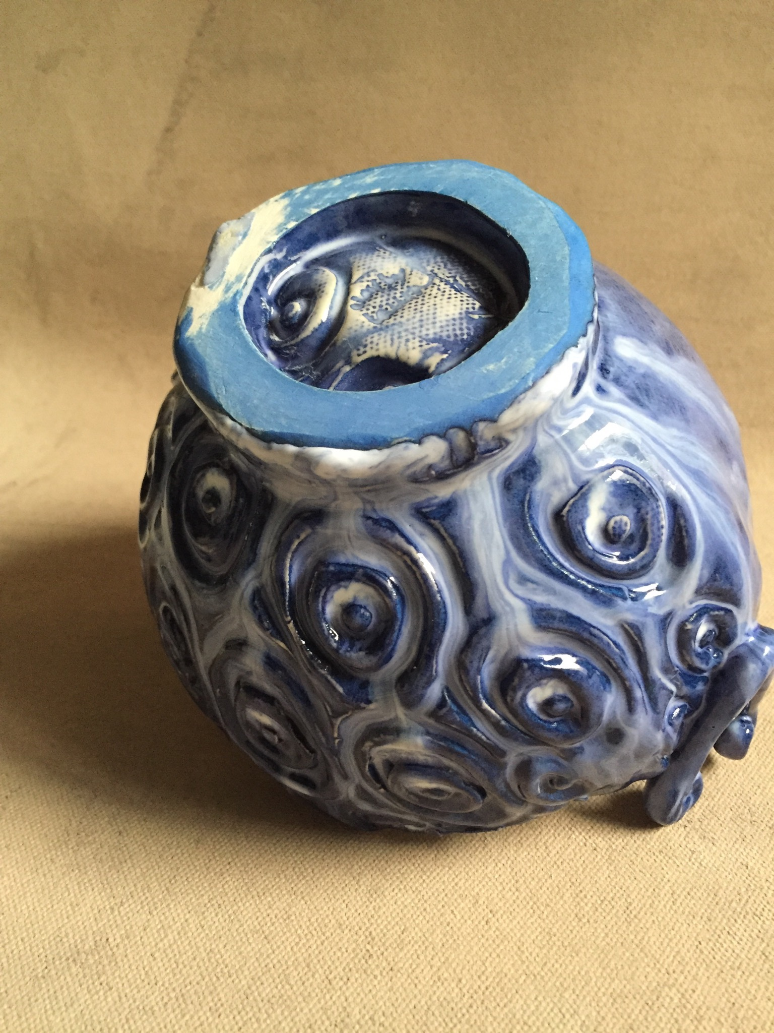 Here's one example of glaze running down the side of a pot and sticking to the shelf.