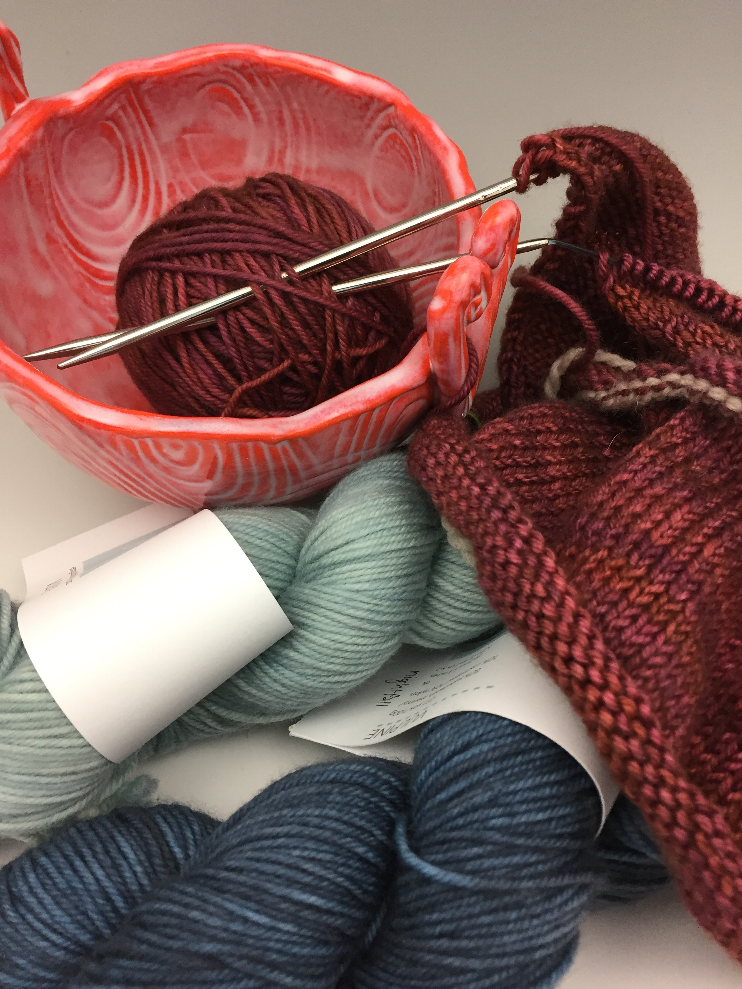 I've got a new knitting project on my needles. I picked up the Little Fox yarn at a trunk show hosted by The Knot House and couldn't resist the  Blue Sand Cardigan  sweater sample I saw there. So this is what I'm working on by the fire each night!