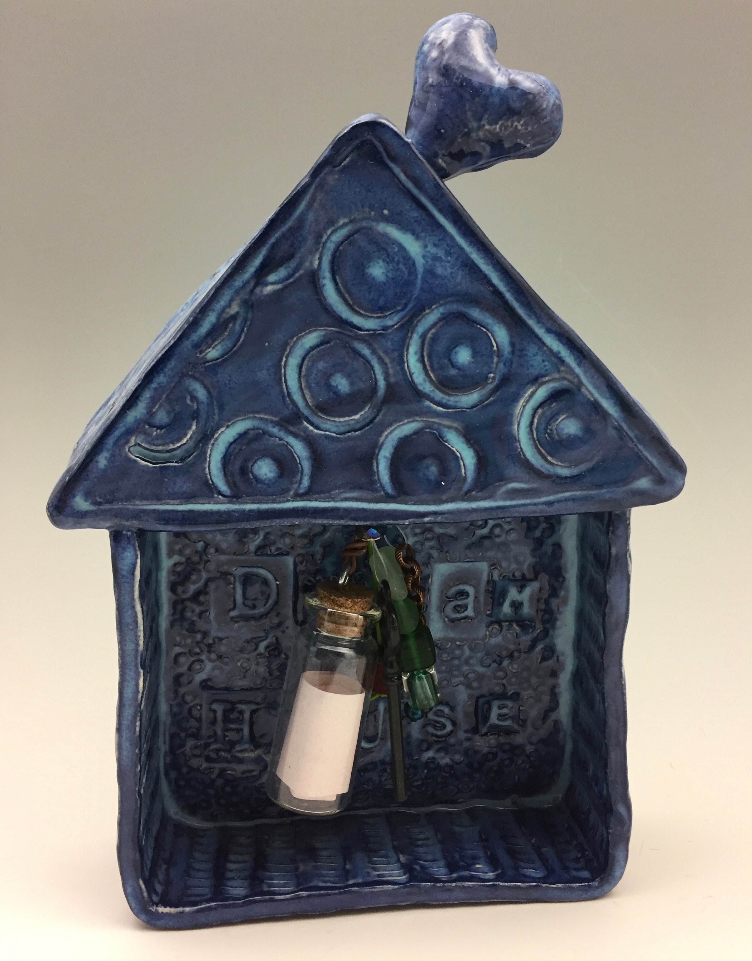 If you're looking for a dream home, here's your answer. Write down all your hopes and wishes and place them inside the glass vial of this small decorative habitat. Stating your intentions often helps make them come true for you! Want to own one or gift it to a friend? Click on the photo.