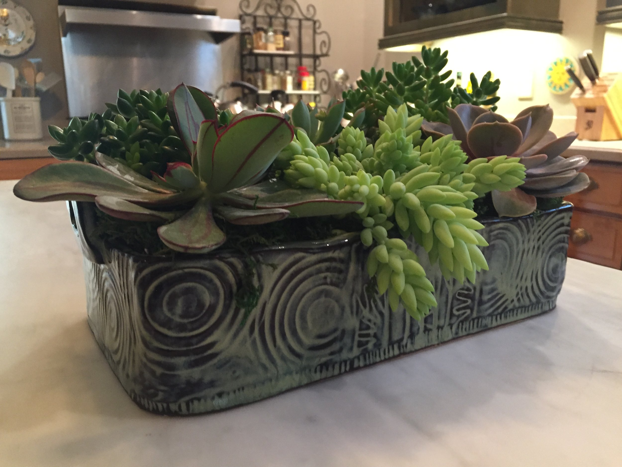 I would never have thought of this! This baking dish has been given a new assignment for an Art Tour in its beautiful Southern home! How clever. I am always getting new ideas for my pieces from their owners!