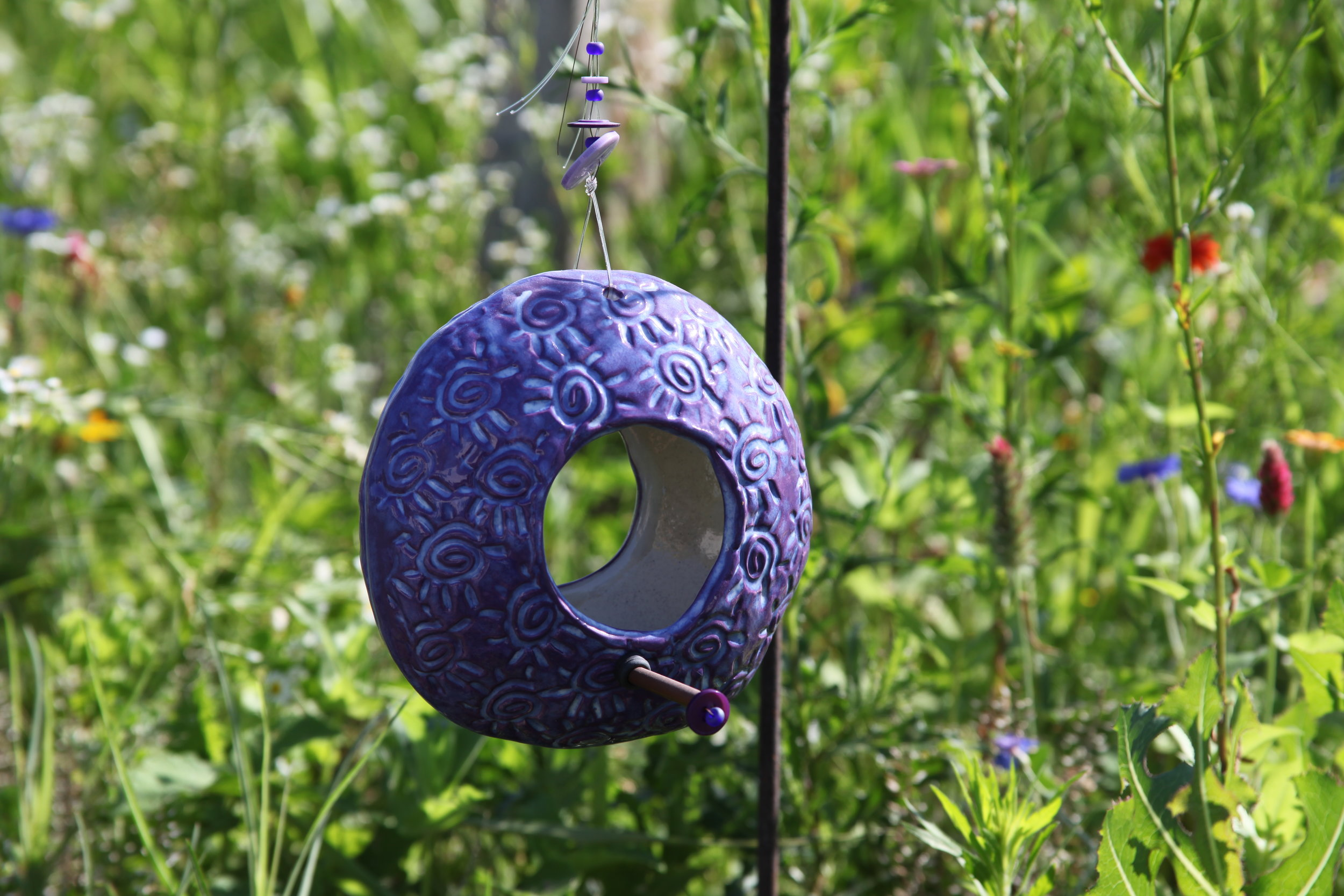 Click on this photo to choose a bird feeder for your yard.