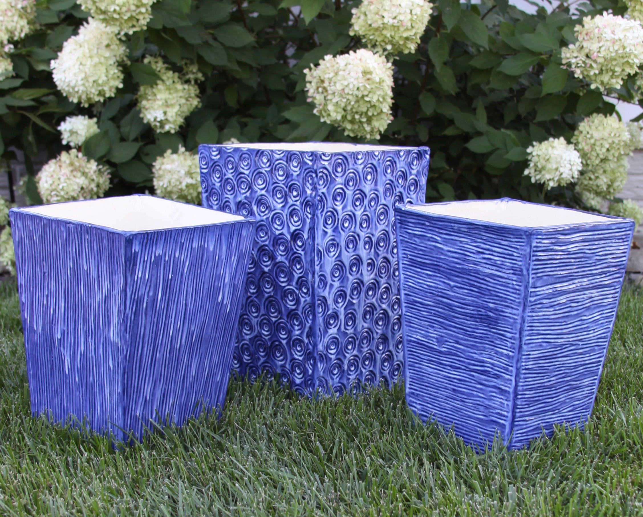 This set of planters will grace an outdoor spa in South Carolina. This custom project was fun to create. The largest one measures 15 inches tall! These three pieces took up the entire kiln when they were fired.