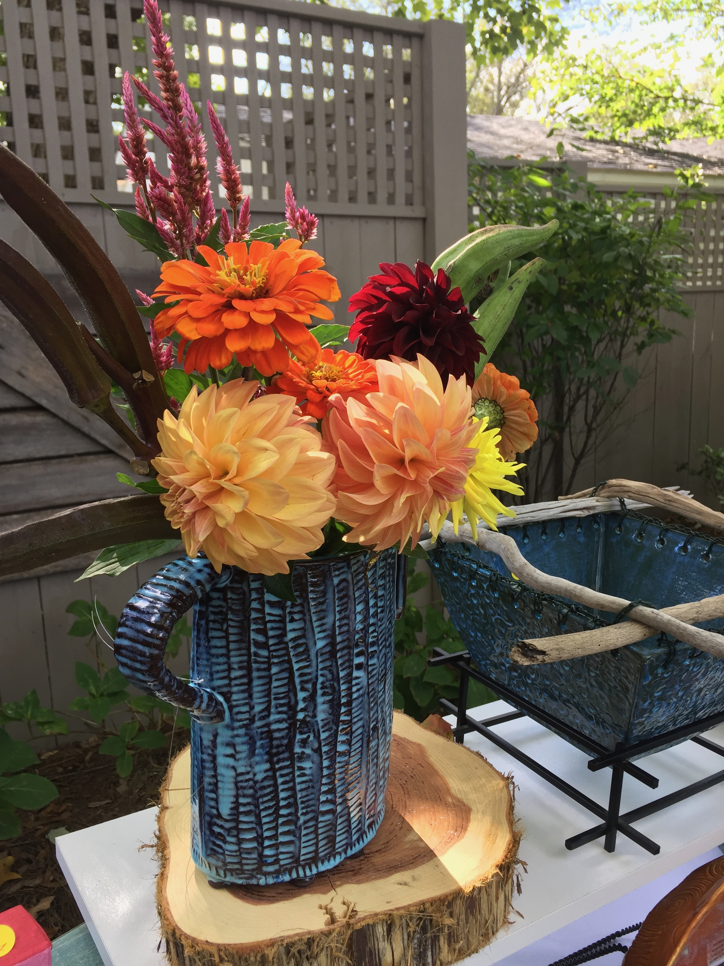 Buy yourself some flowers. Use that sweet tea pitcher on hiatus to house a beautiful bunch of color. Place it where you'll see it most often! Need a pitcher to hold your flower bunch? Click photo to purchase.