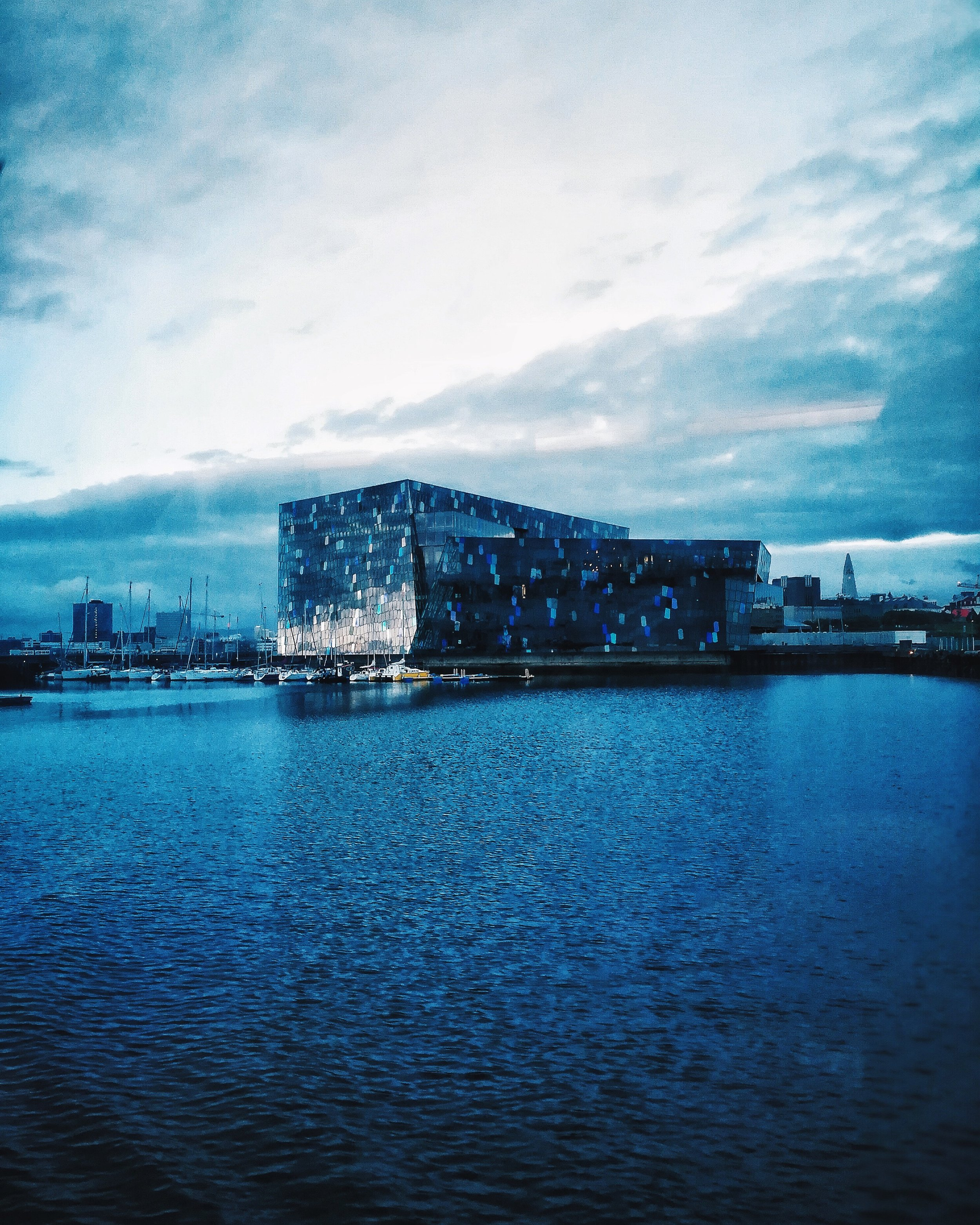 view of Harpa from the water in Iceland