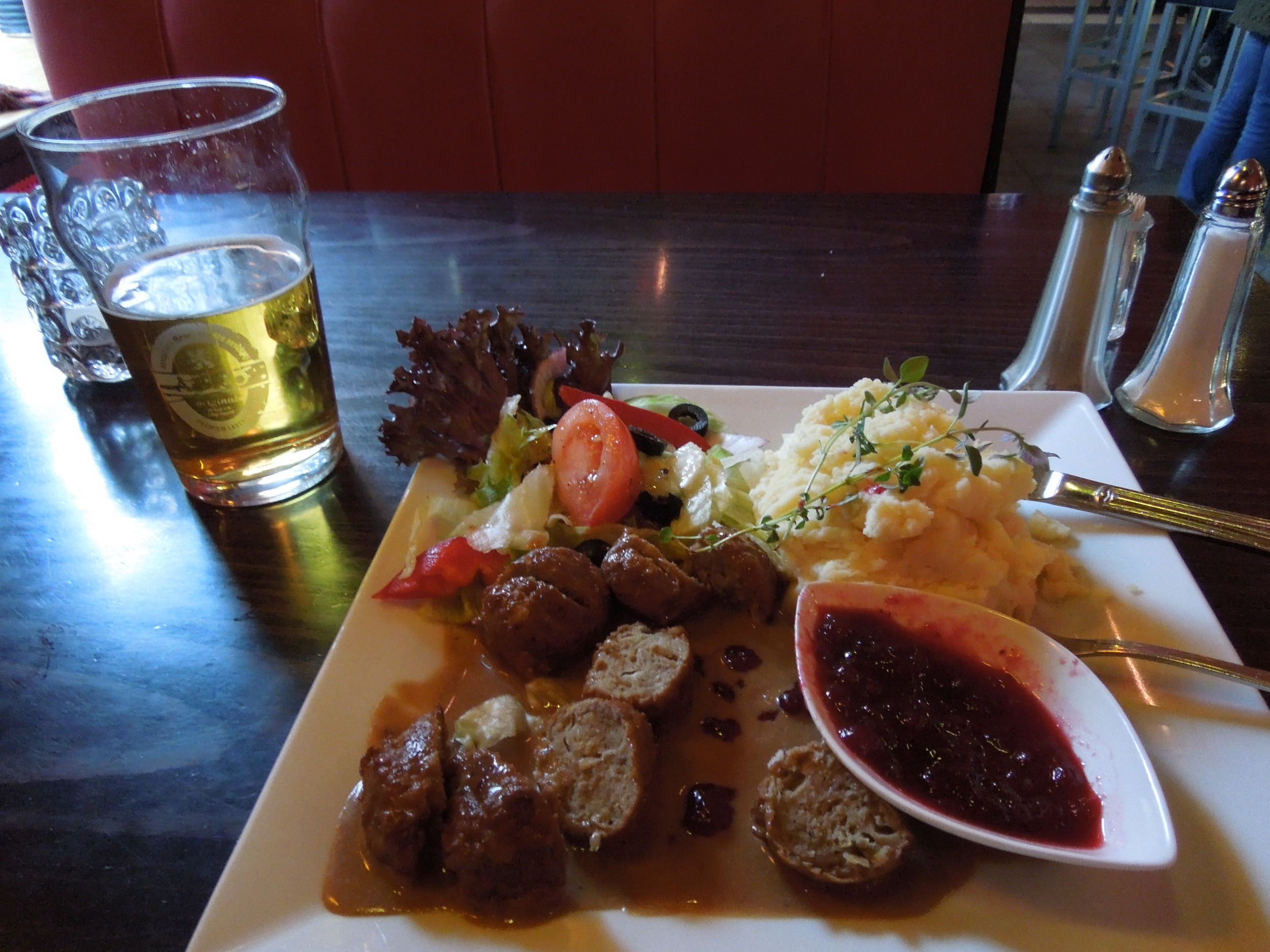 Swedish meatballs served with lingonberries, with Swedish beer Åbro to wash it all down
