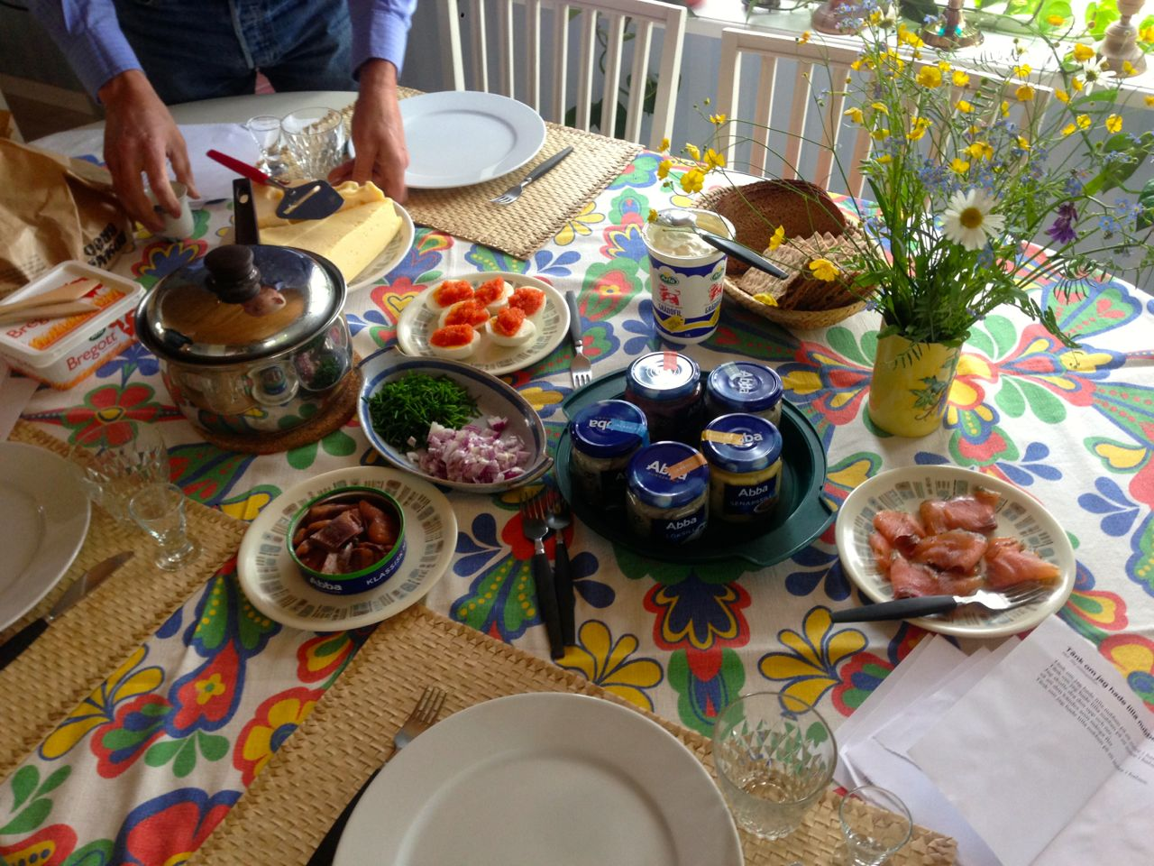 Traditional Swedish midsummer lunch with herring and boiled potatoes, among other things