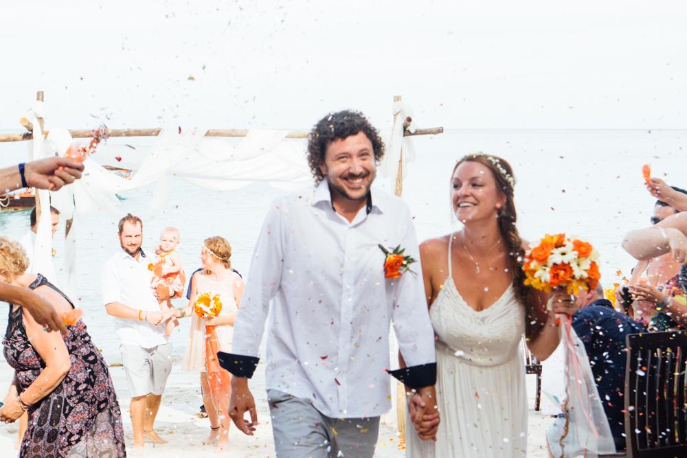 couple walks down isle, haad yuan, thailand wedding