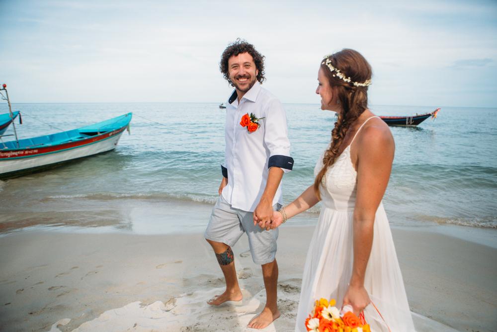 couple walks on beach haad yuan, thailand wedding