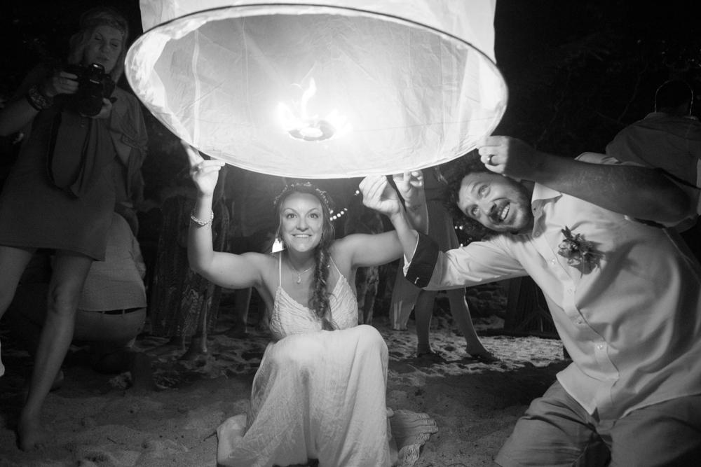 couple lights paper lantern, haad yuan, thailand wedding