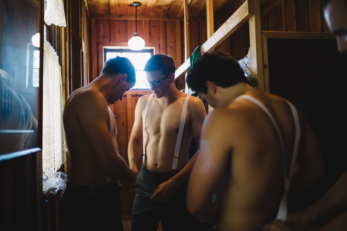 The Groomsmen working together in preparing for the wedding ceremony King Francis Park Forest Wedding Vancouver Island