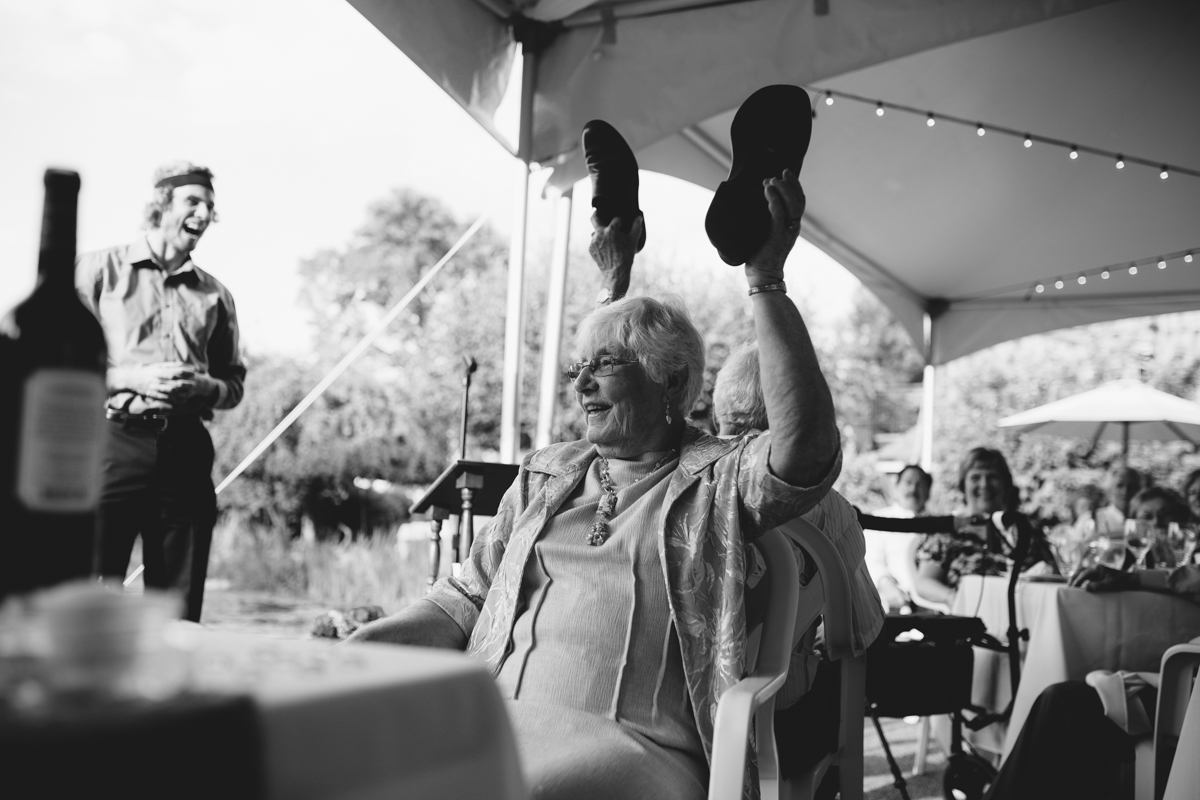 a lady holding her shoes at a wedding ceremony The Guild King Francis Park Forest Wedding Ceremony Vancouver Island