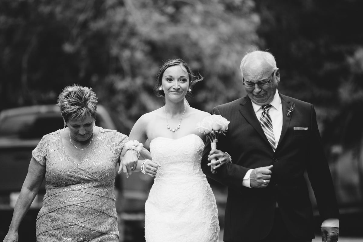 Bride being escorted Provincial Park wedding Clear Lake Manitoba