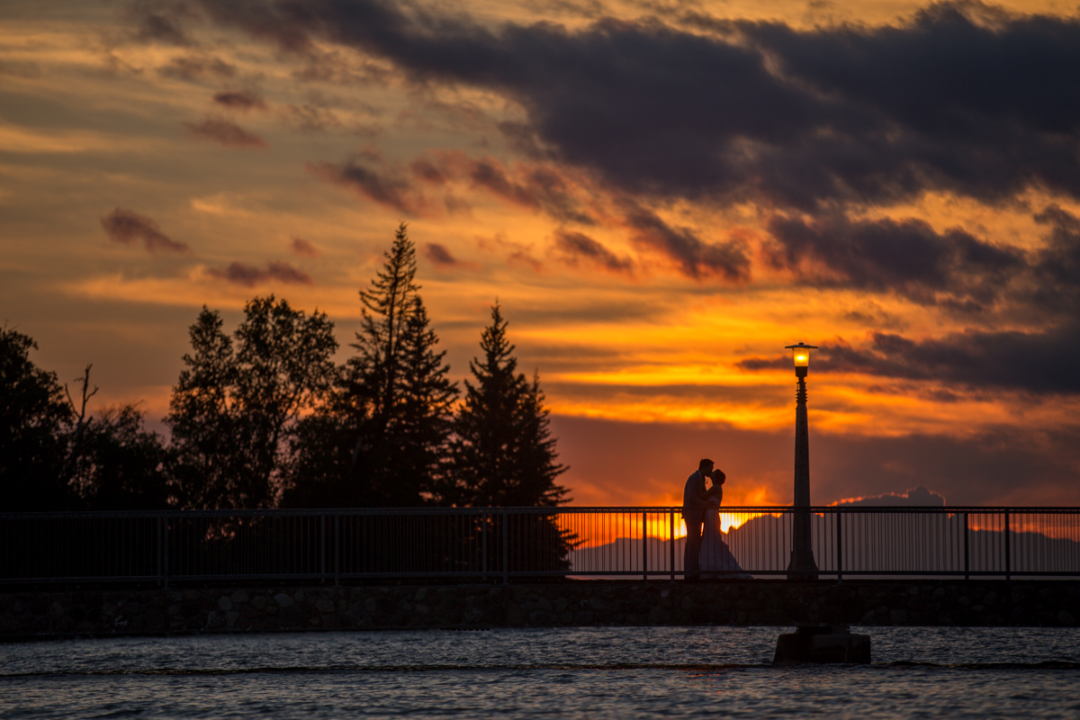 Bride and Groom Sunset kiss Newly married couple Provincial Park wedding ceremony Clear Lake Manitoba