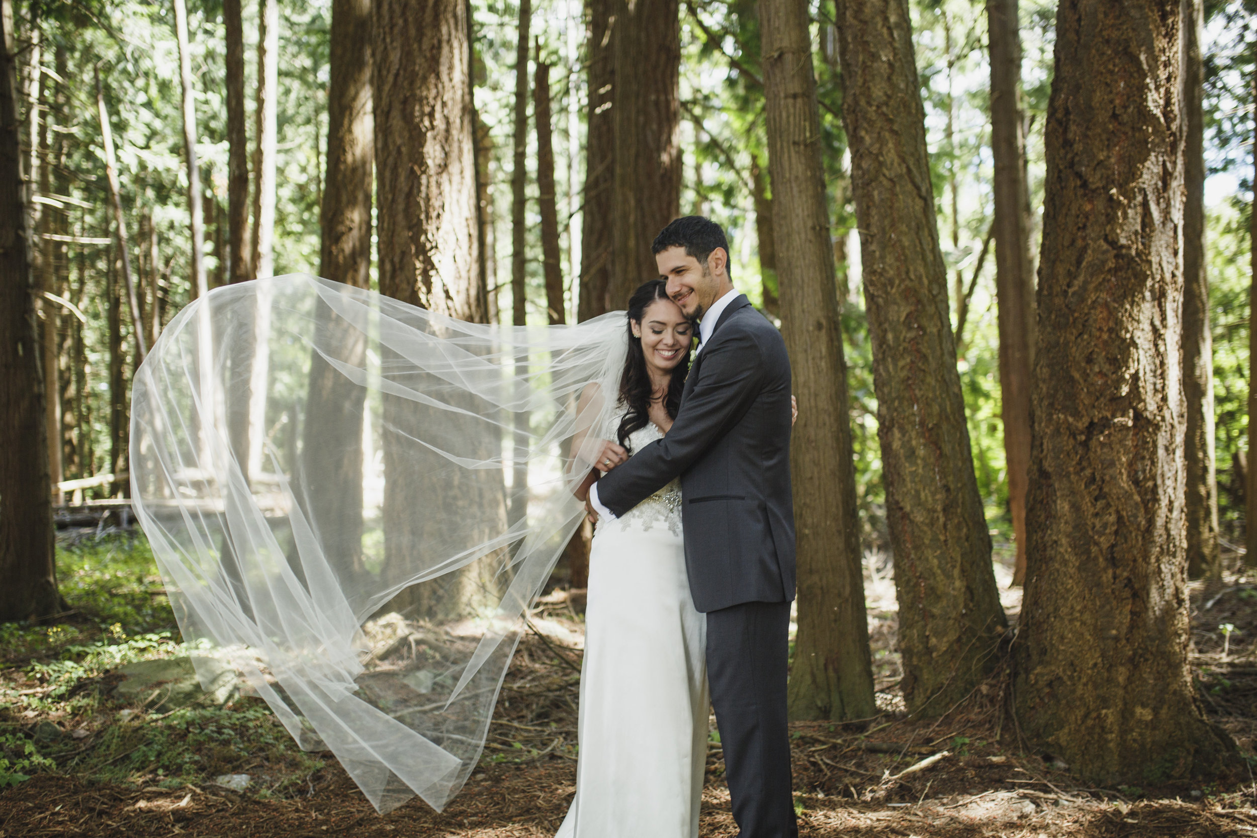 Bride and Groom poses for their forest wedding ceremony at Sea Cider in Vancouver Island