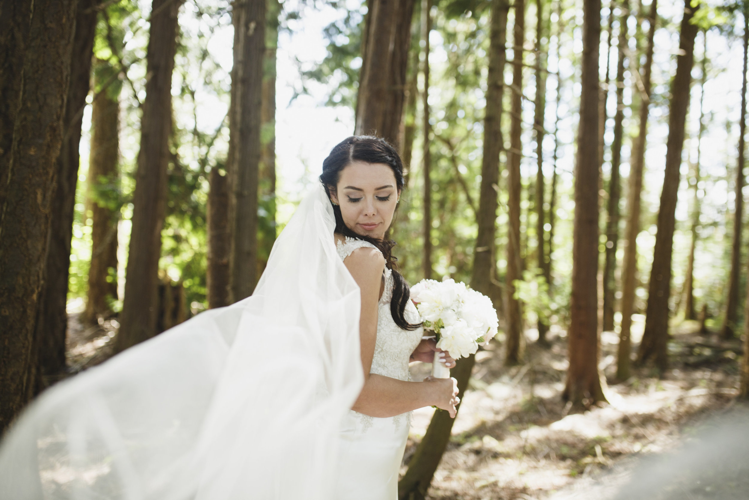 The bride holding her bouquet of flowers Forest wedding Tofino Sea CIder Vancouver Island