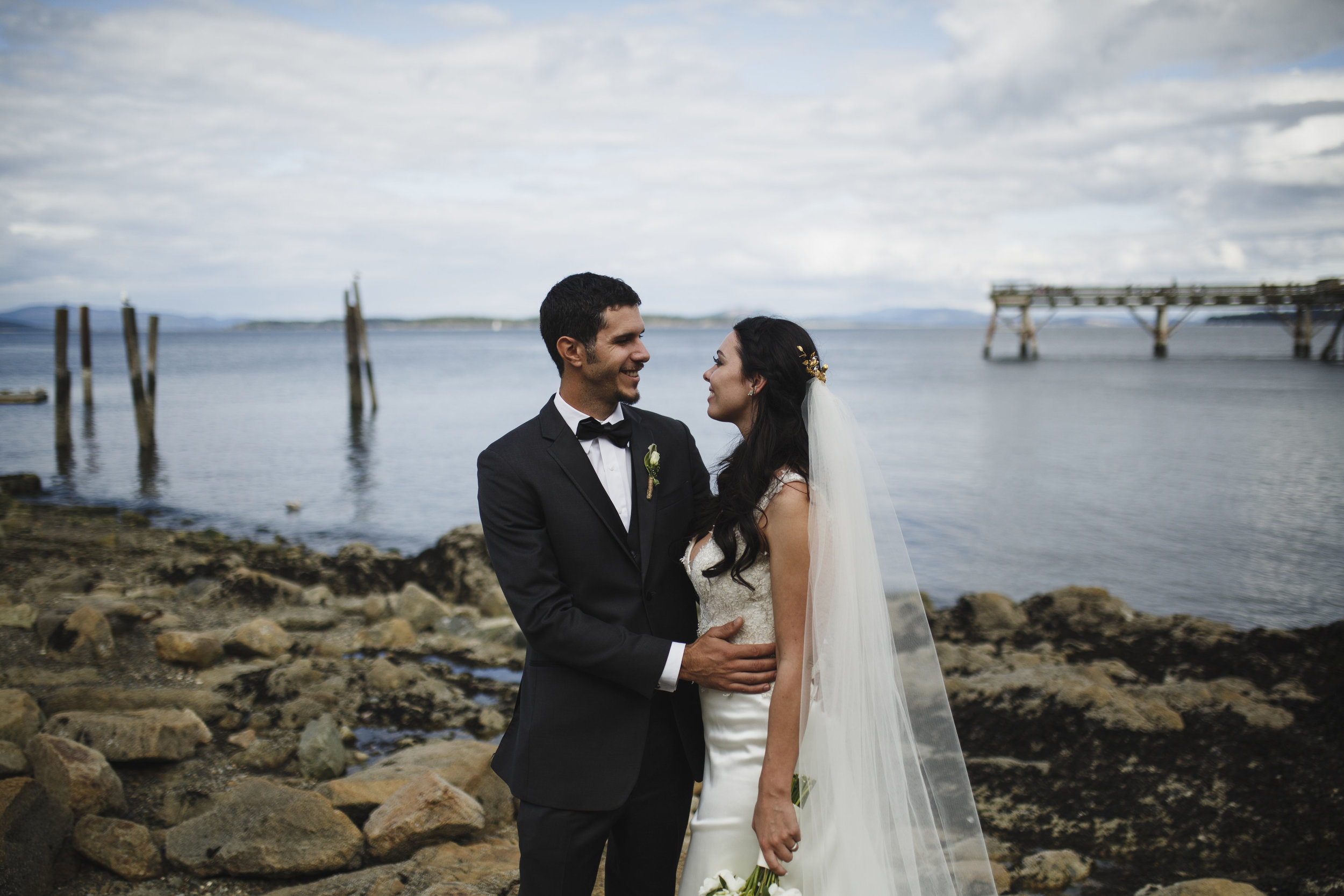 The bride and the groom smiling at each other Beach wedding Tofino Sea Cider Vancouver Island