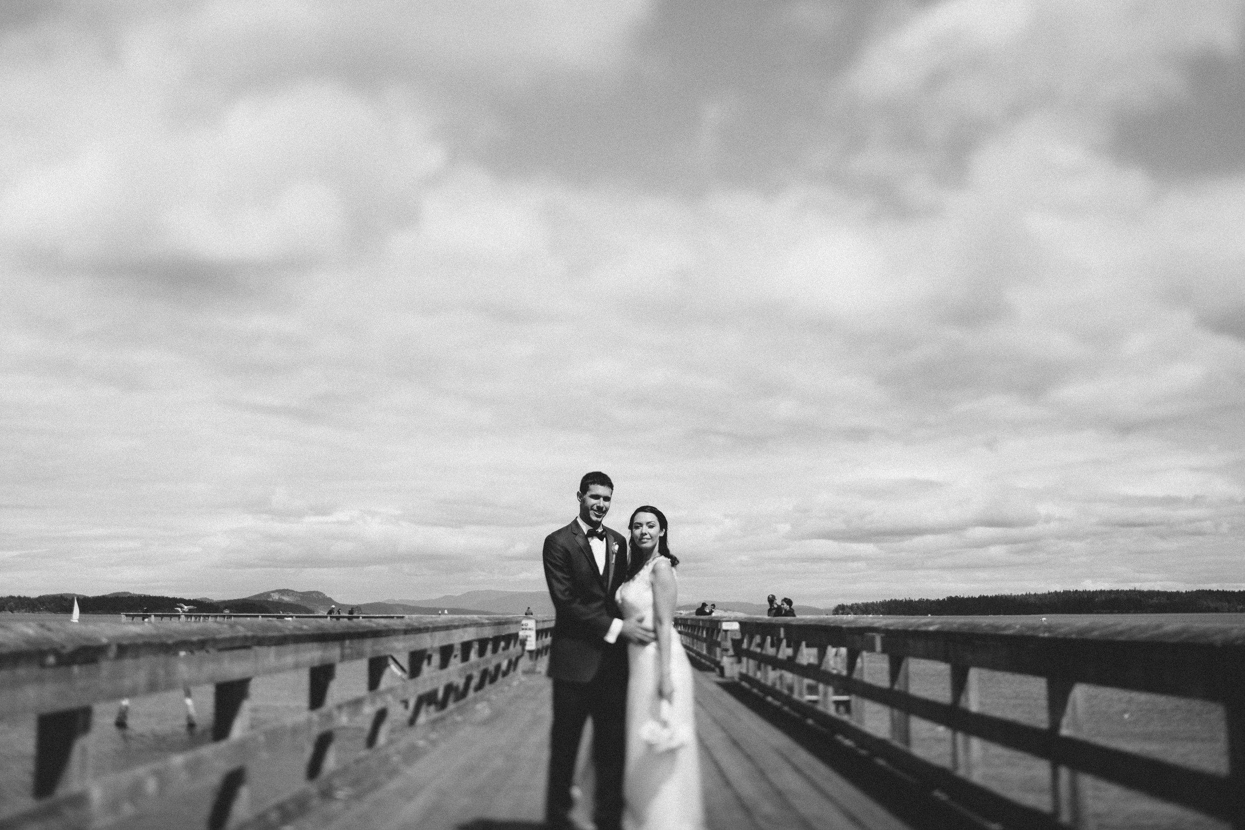 A picture of the bride and the groom in a bridge Beach wedding Sea Cider Tofino Vancouver Island