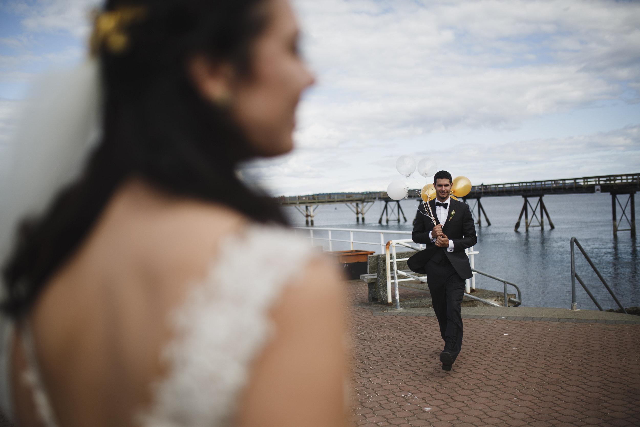 The groom walks towards his bride Tofino Sea Cider Beach wedding Vancouver Island