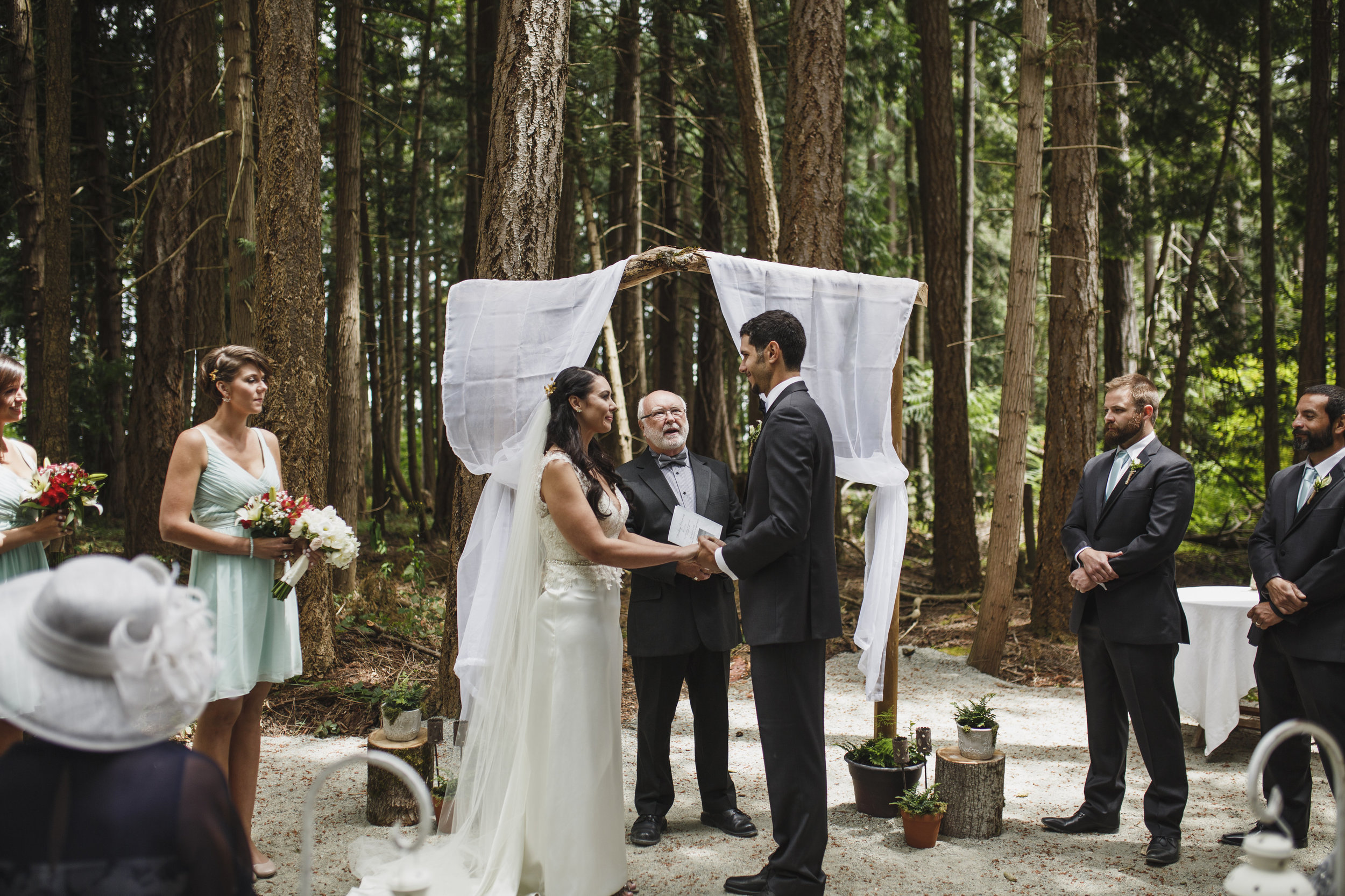 Bride and groom looks at each Forest Wedding Tofino Sea Cider Vancouver Island