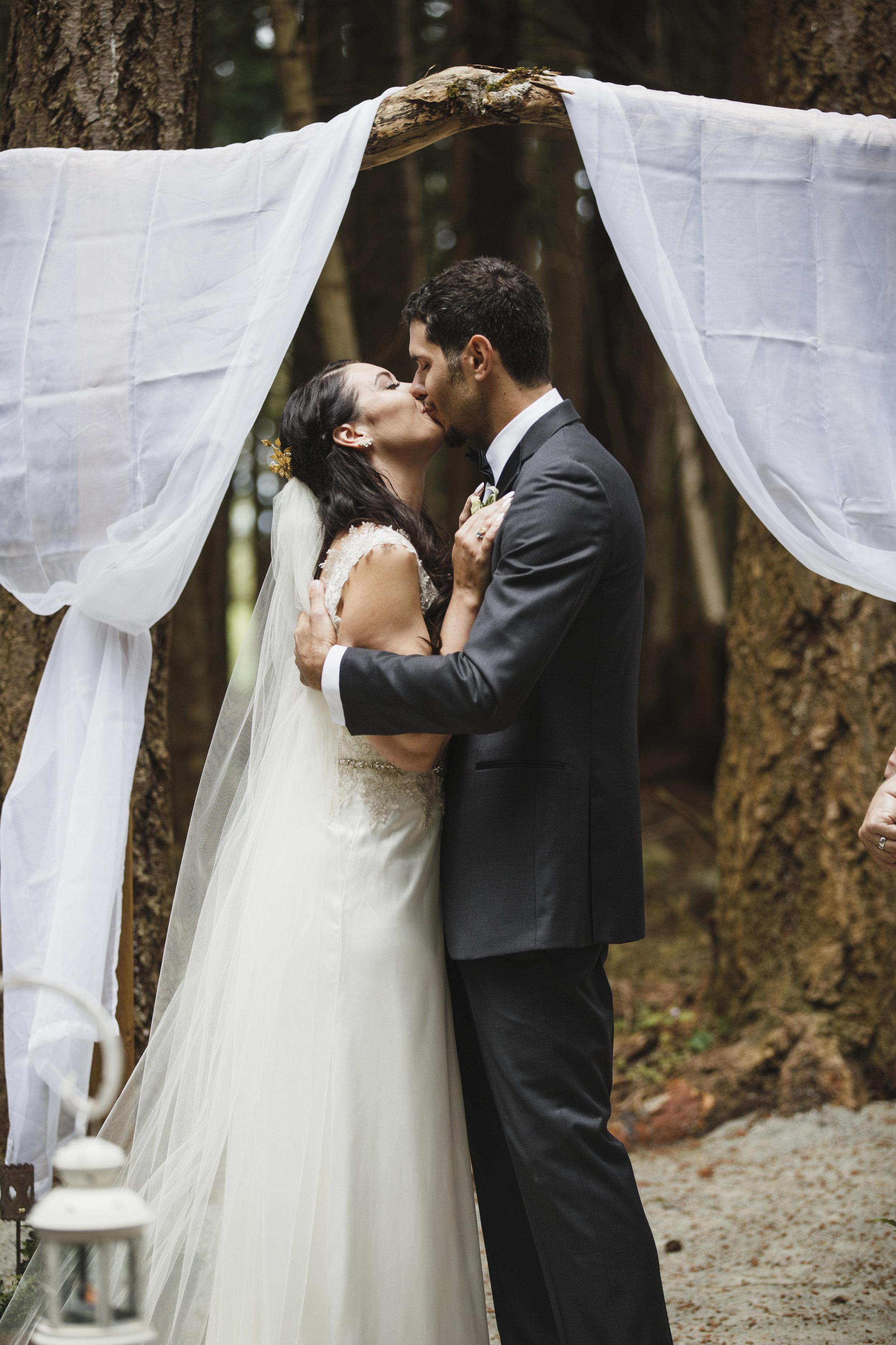 Groom kisses his bride Forest wedding Tofino Sea Cider Vancouver Island
