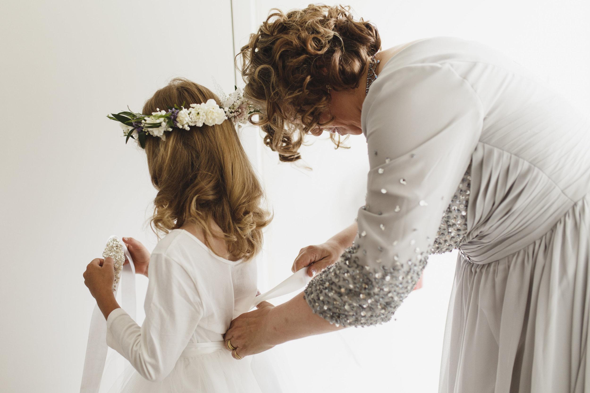A bridesmaid getting ready Sea Cider wedding Vancouver Island