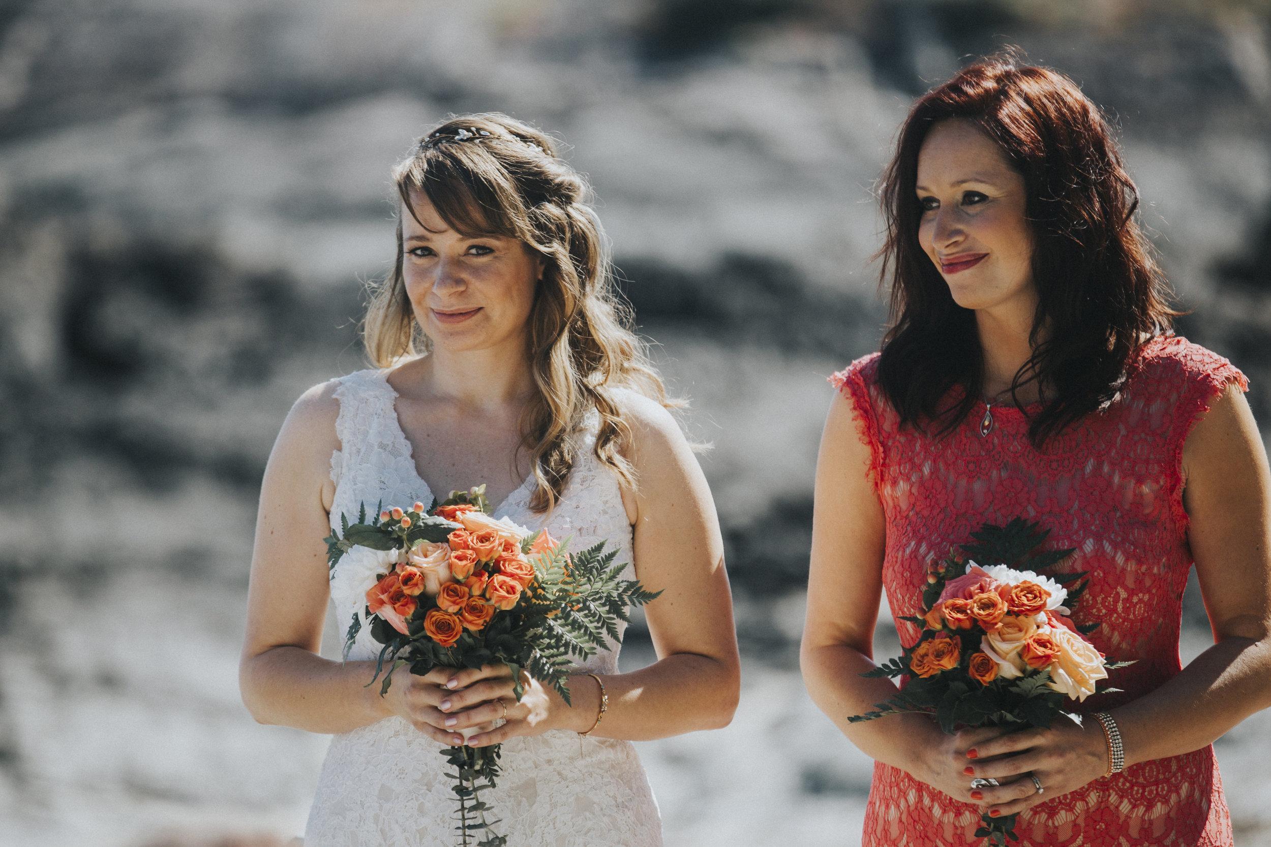 bride with sister at wedding ceremony seashell beach tofino